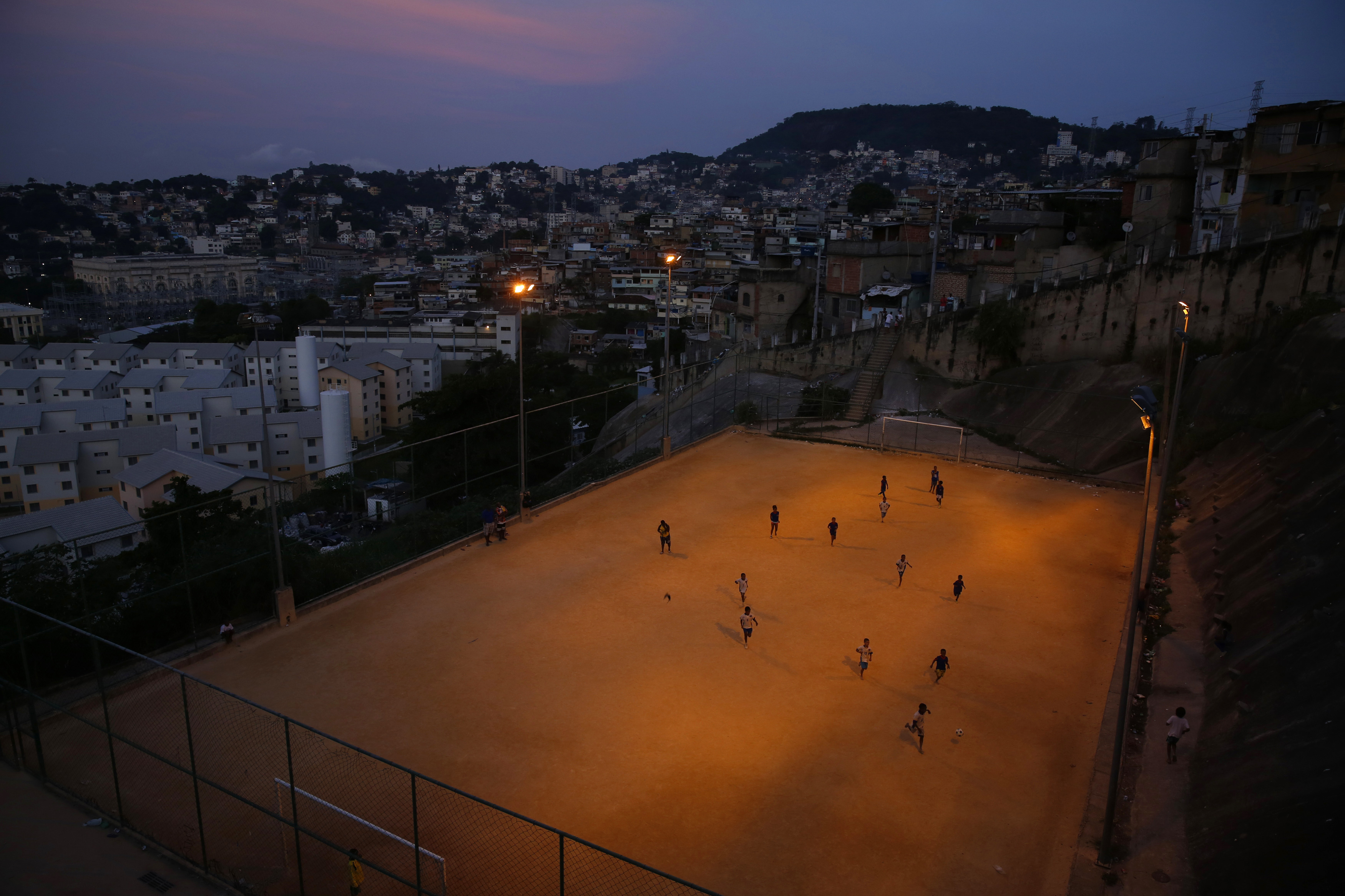 Kids play soccer during a training session at Sao Carlos slum in Rio de Janeiro May 15, 2014.