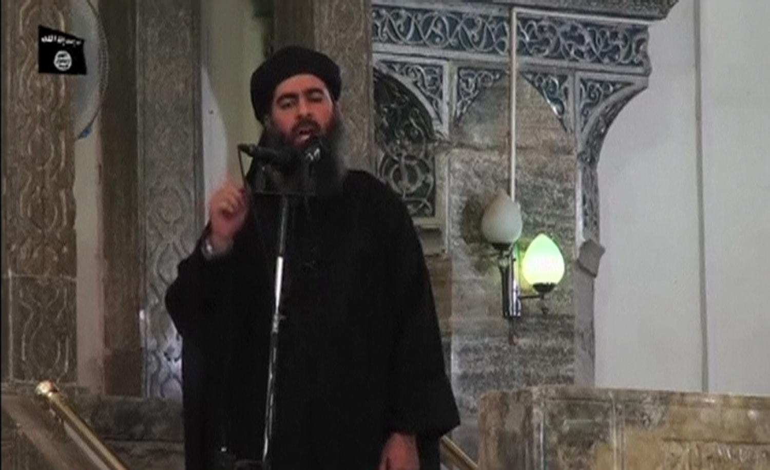 A man purported to be Abu Bakr al-Baghdadi, the leader of the miltant group ISIS, during what would have been his first public appearance at a mosque in Mosul, according to a video recording posted on the Internet.