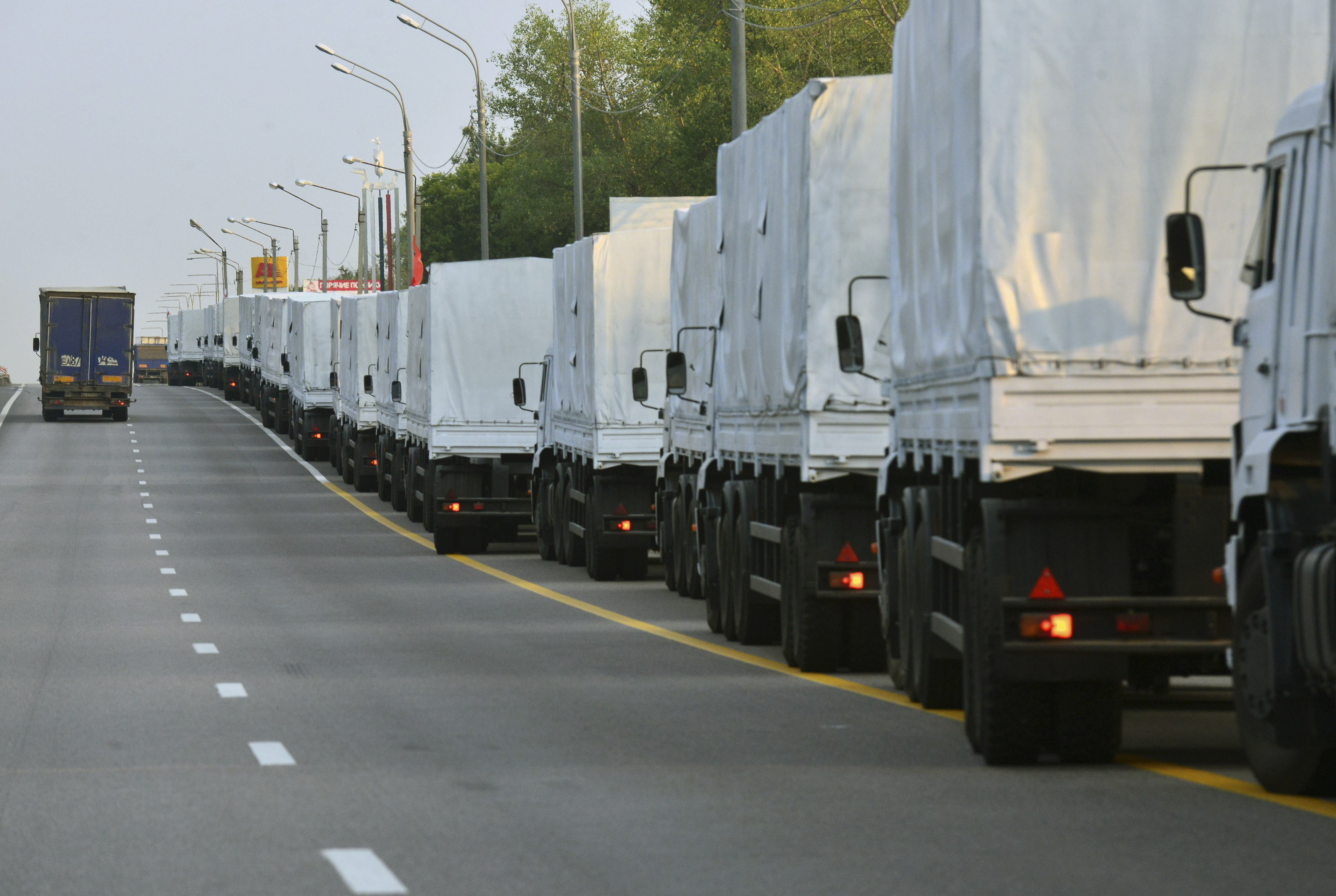 A Russian convoy of trucks carrying humanitarian aid for Ukraine stops along a road in the city of Voronezh August 12, 2014. The convoy carrying tons of humanitarian aid left on Tuesday for eastern Ukraine, where government forces are closing in on pro-Ru