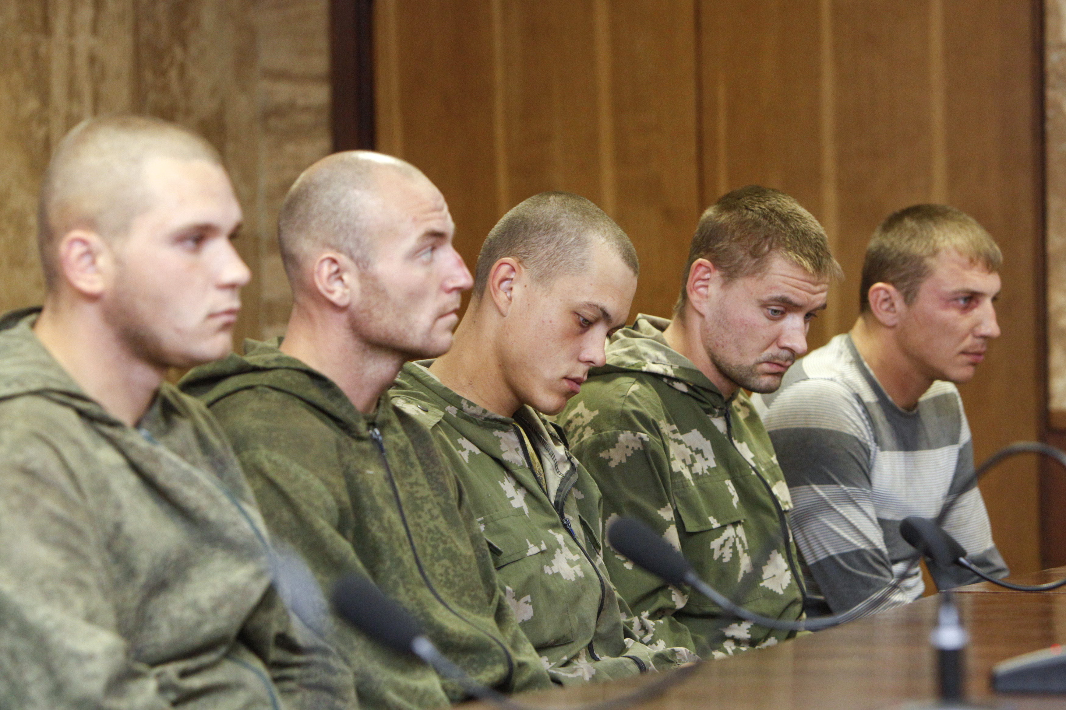 """A group of Russian servicemen detained by Ukrainian authorities attend a news conference in Kiev on August 27, 2014. Ukraine said on Tuesday its forces had captured a group of Russian paratroopers who had crossed into Ukrainian territory on a """"special mis"""