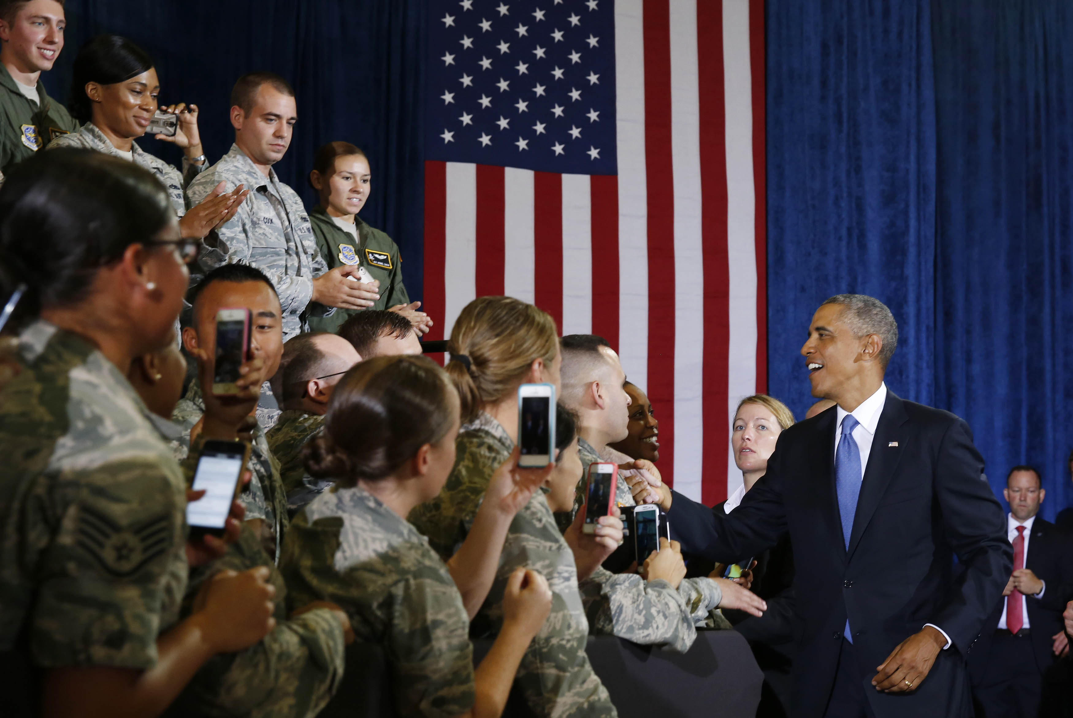 President Barack Obama shakes hands before speaking at MacDill Air Force Base in Tampa, Florida.