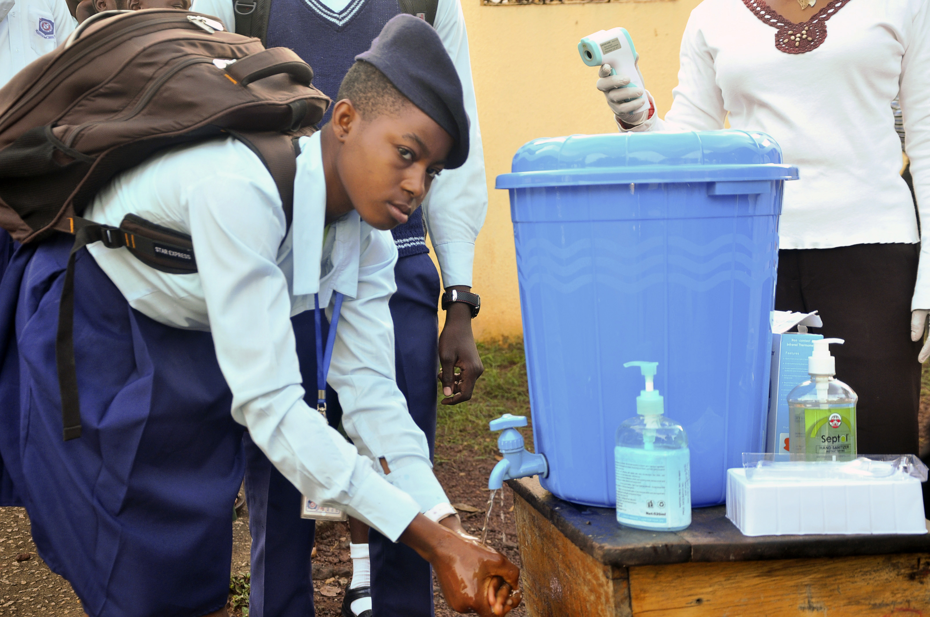 A student at Goverment Secondary School Garki washes her hands, as school resumed in Abuja, Nigeria, in late September.