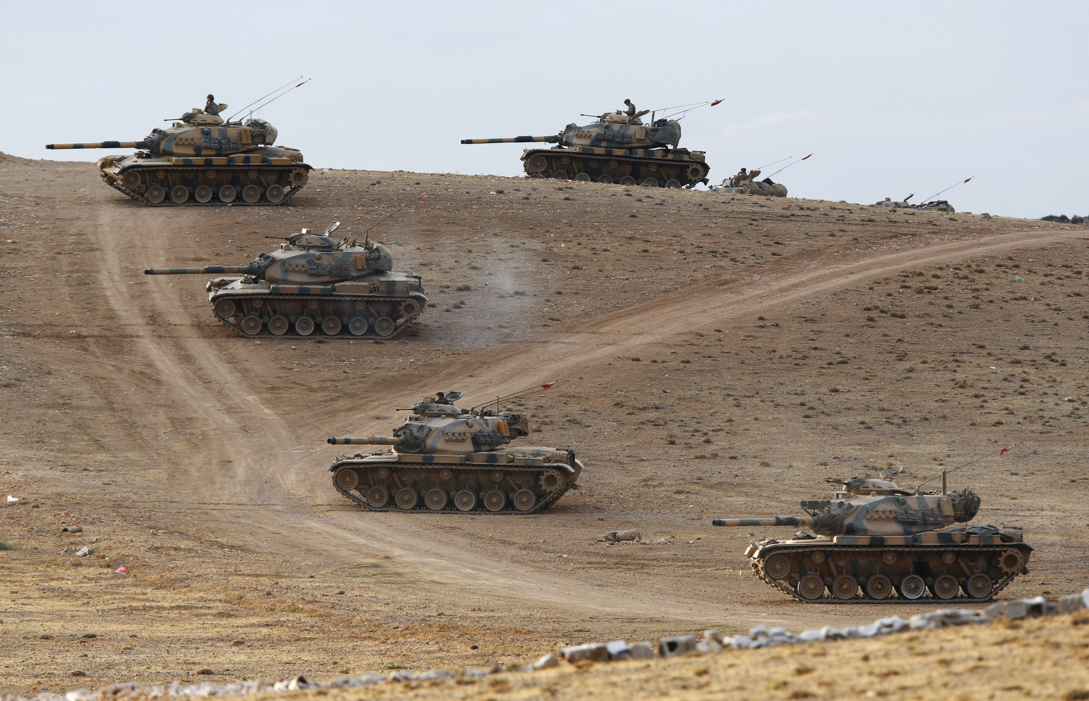 Turkish tanks taking up position on the Turkish-Syrian border on September 29, 2014, after stray fire landed on Turkish territory. Turkey is concentrating forces along the border ahead of a parliamentary debate on authorizing military intervention in Syri
