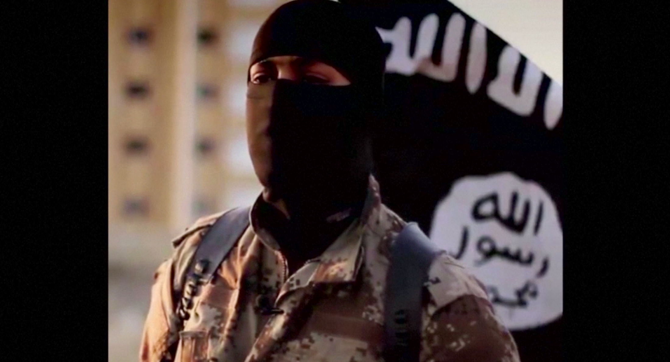 A masked man speaking in what is believed to be a North American accent is pictured in a video that ISIS militants released in September 2014.
