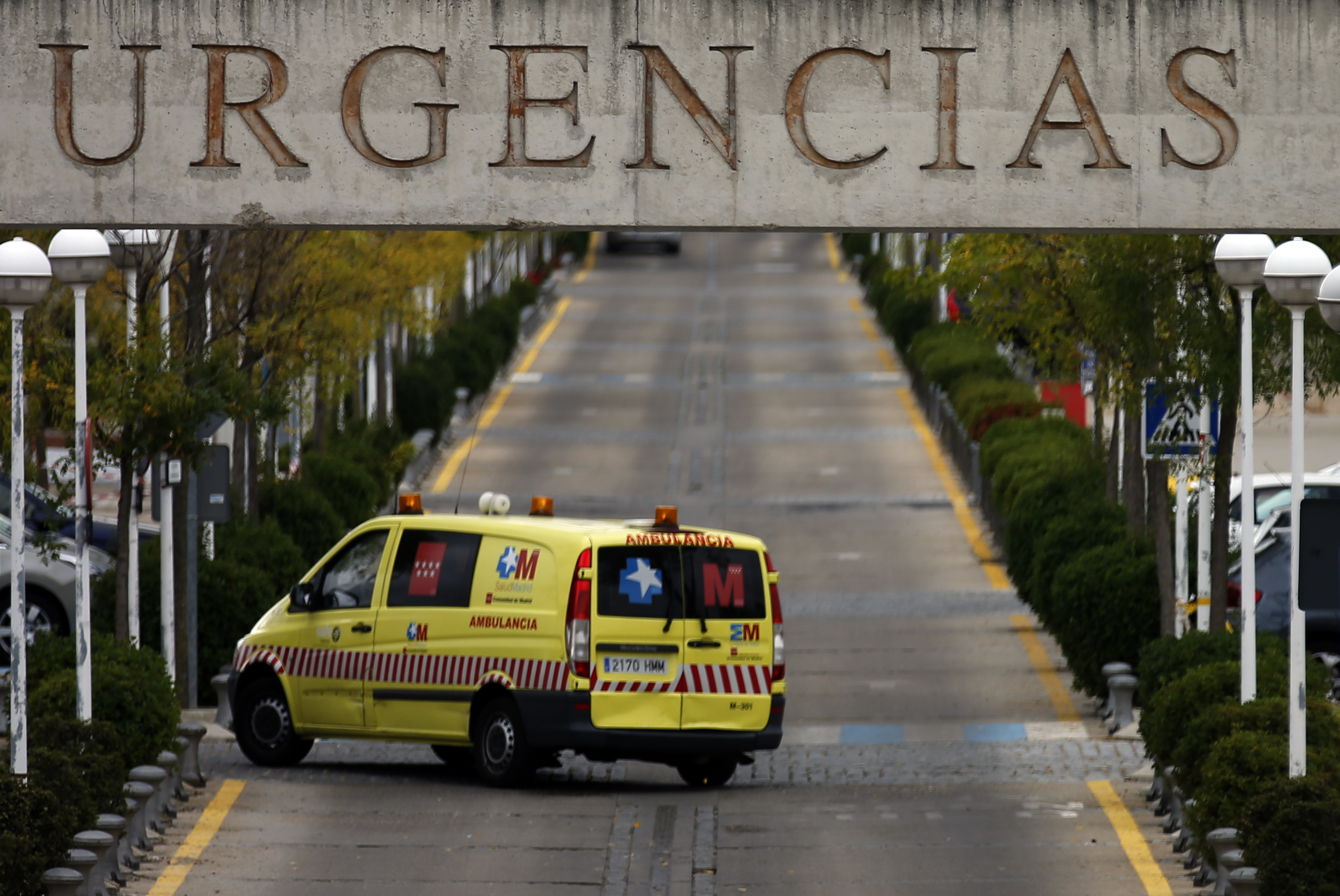 An ambulance enters the emergency area at the Alcorcón hospital outside Madrid. The Spanish nurse who contracted Ebola while treating infected patients is currently in isolation at the facility.