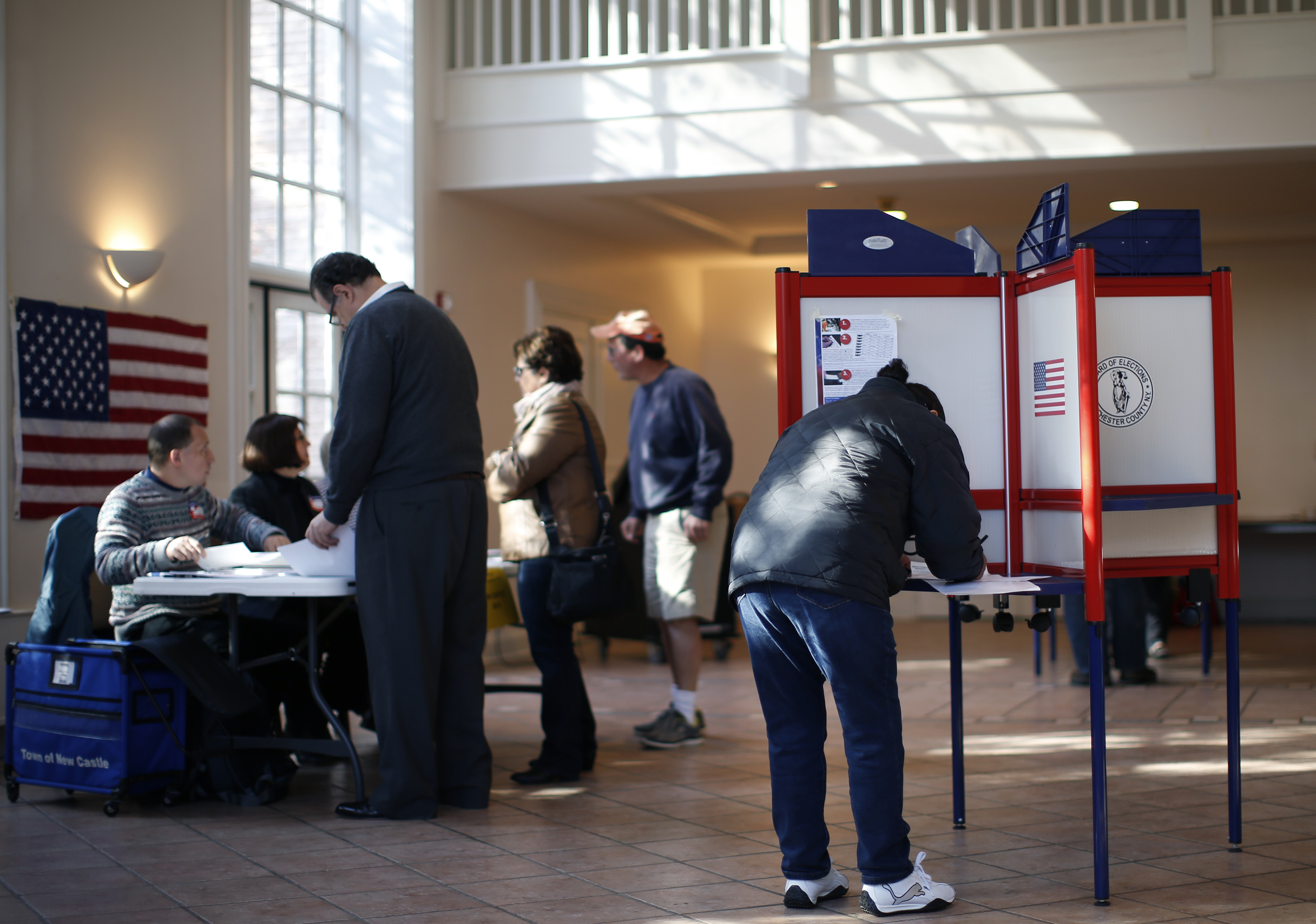 Voters sign in and fill out ballots and at a polling station at the Presbyterian Church in the town of Mount Kisco, New York, on November 4, 2014. Americans were heading to the polls Tuesday in the midterm elections.