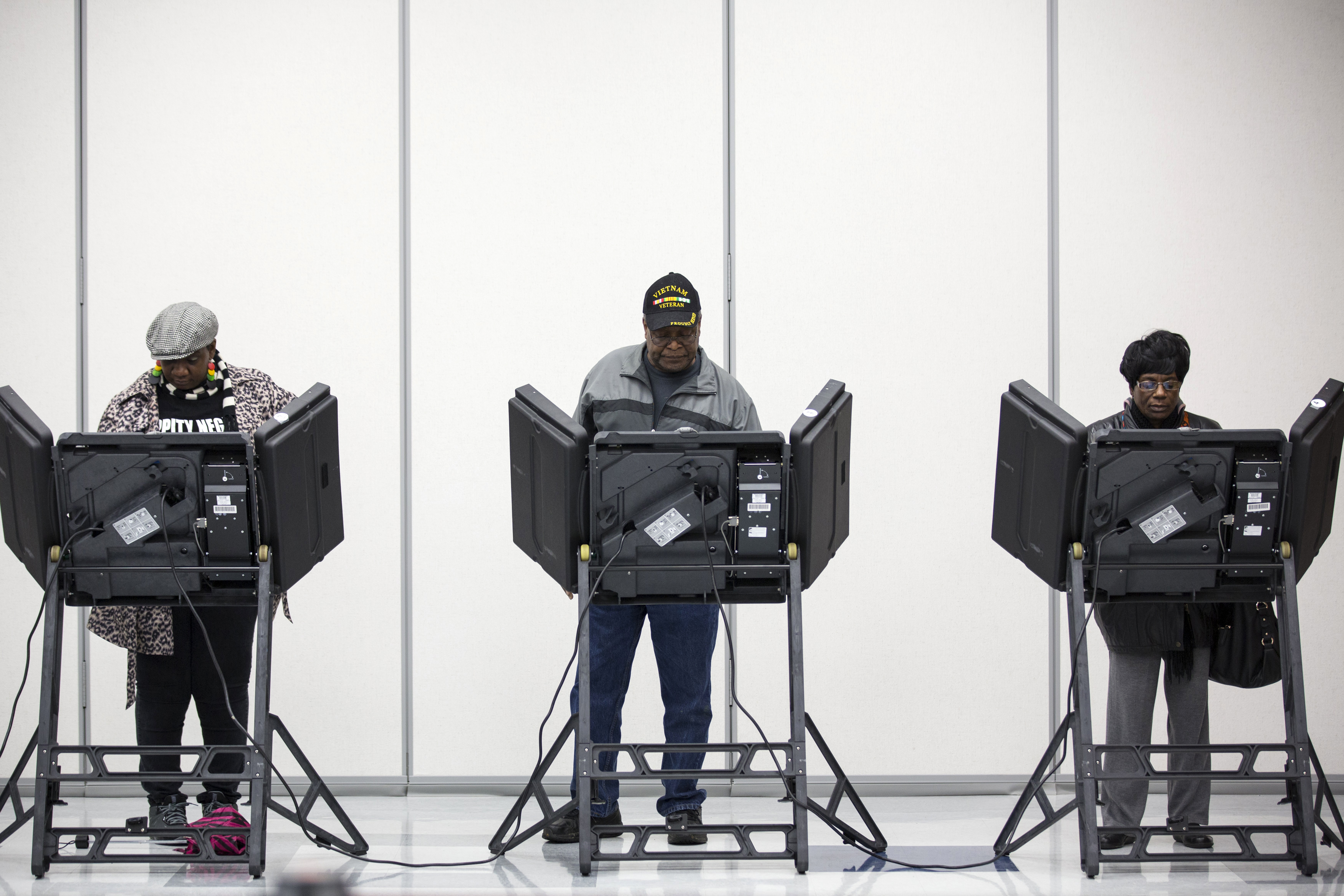Voters cast their ballots in US midterm elections in Ferguson, Missouri, on November 4, 2014.