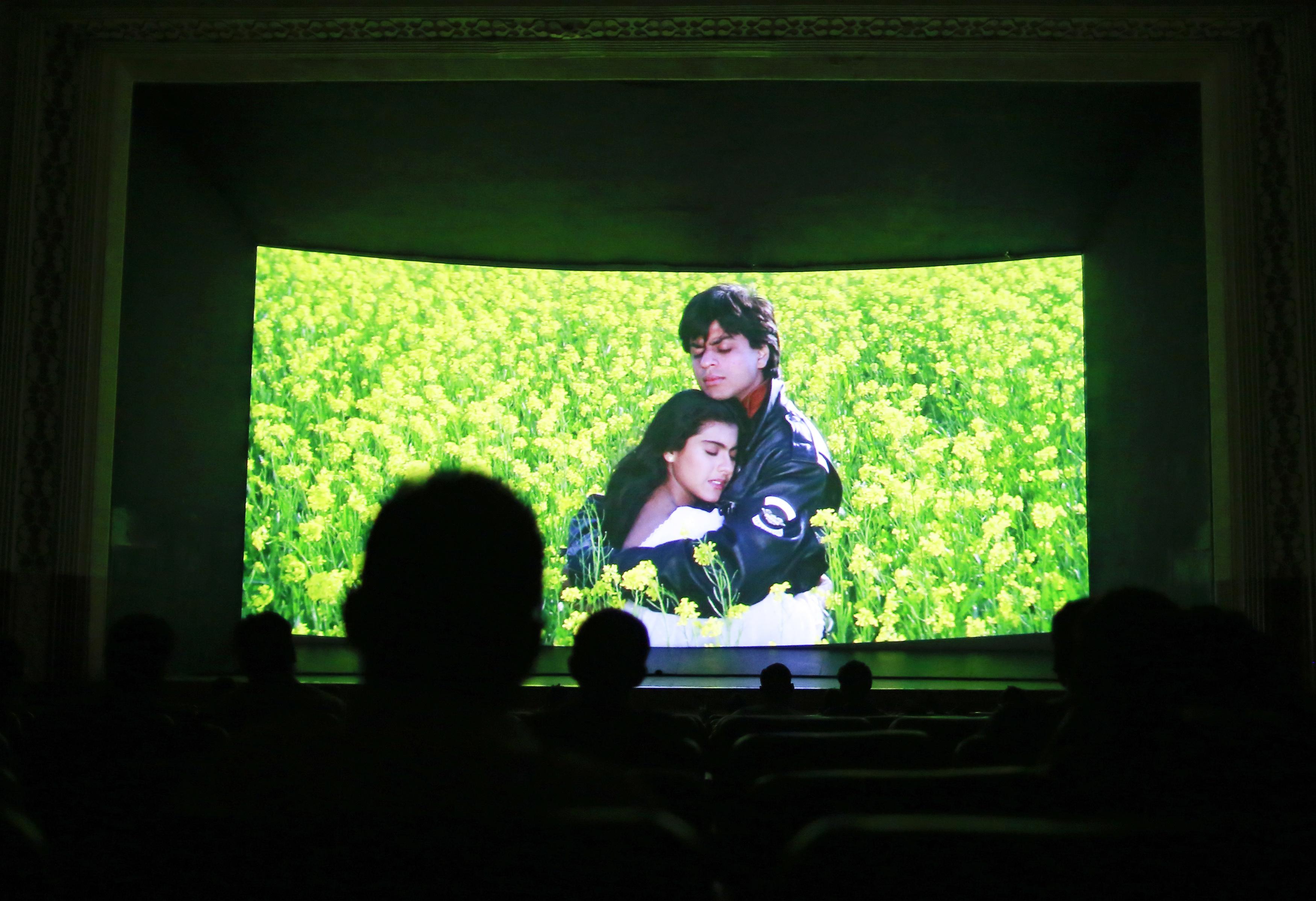 Inside the Mumbai theater, moviegoers look at the screen.