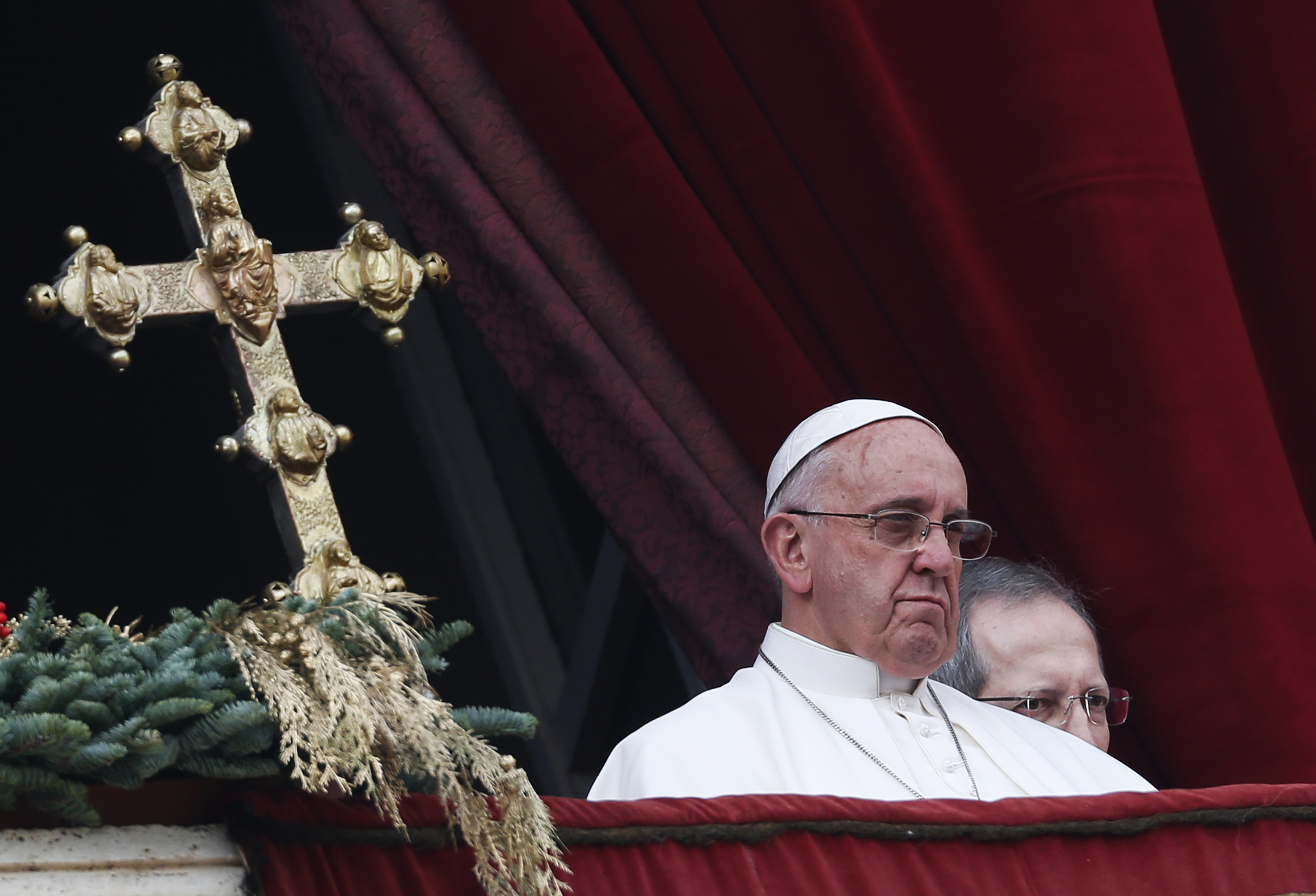 """Pope Francis delivers a """"Urbi et Orbi"""" (to the city and world) message from the balcony overlooking St. Peter's Square at the Vatican on Christmas Day of 2014."""