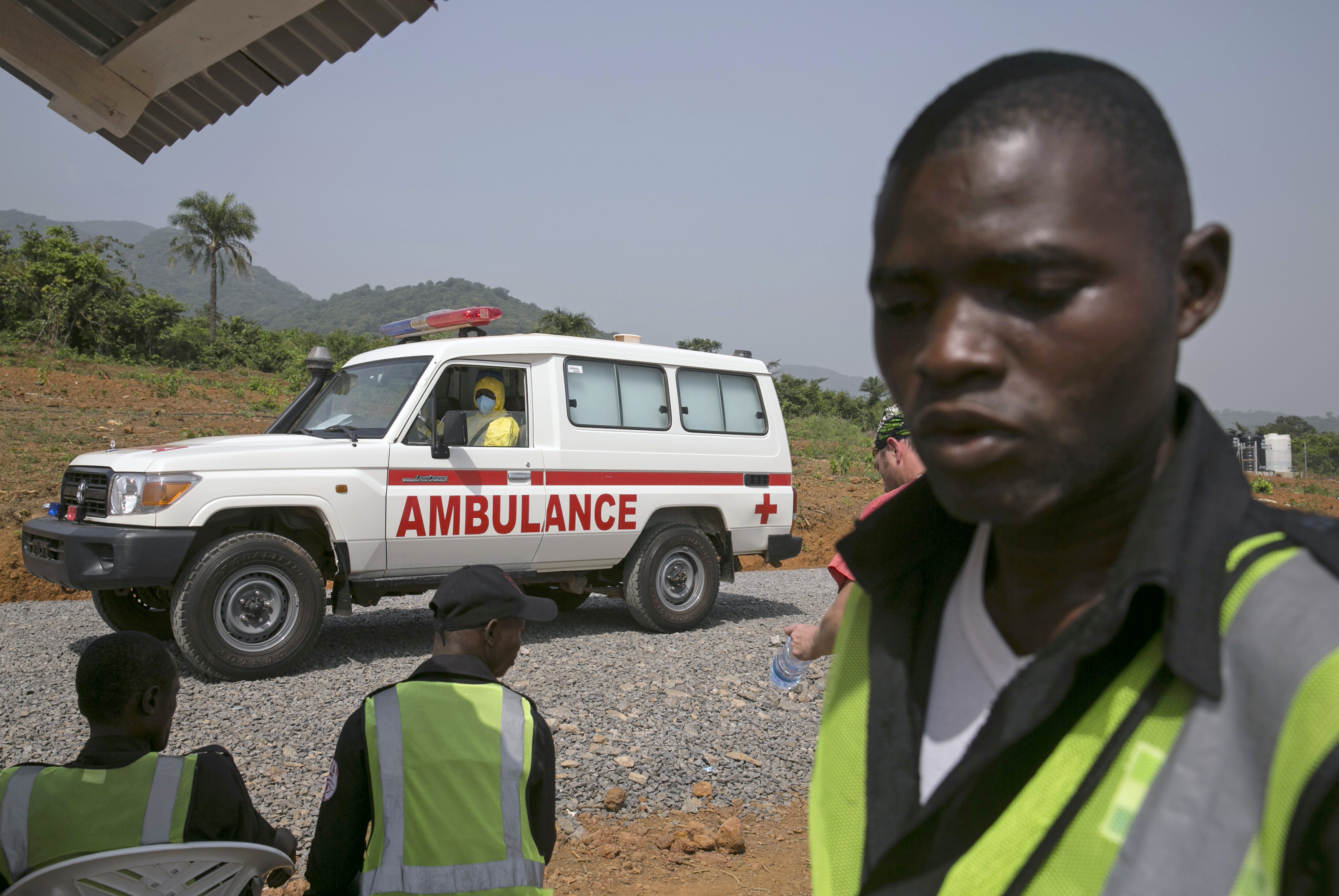 An ambulance transporting an Ebola patient drives to the entrance of a treatment centre outside Freetown, Sierra Leone.