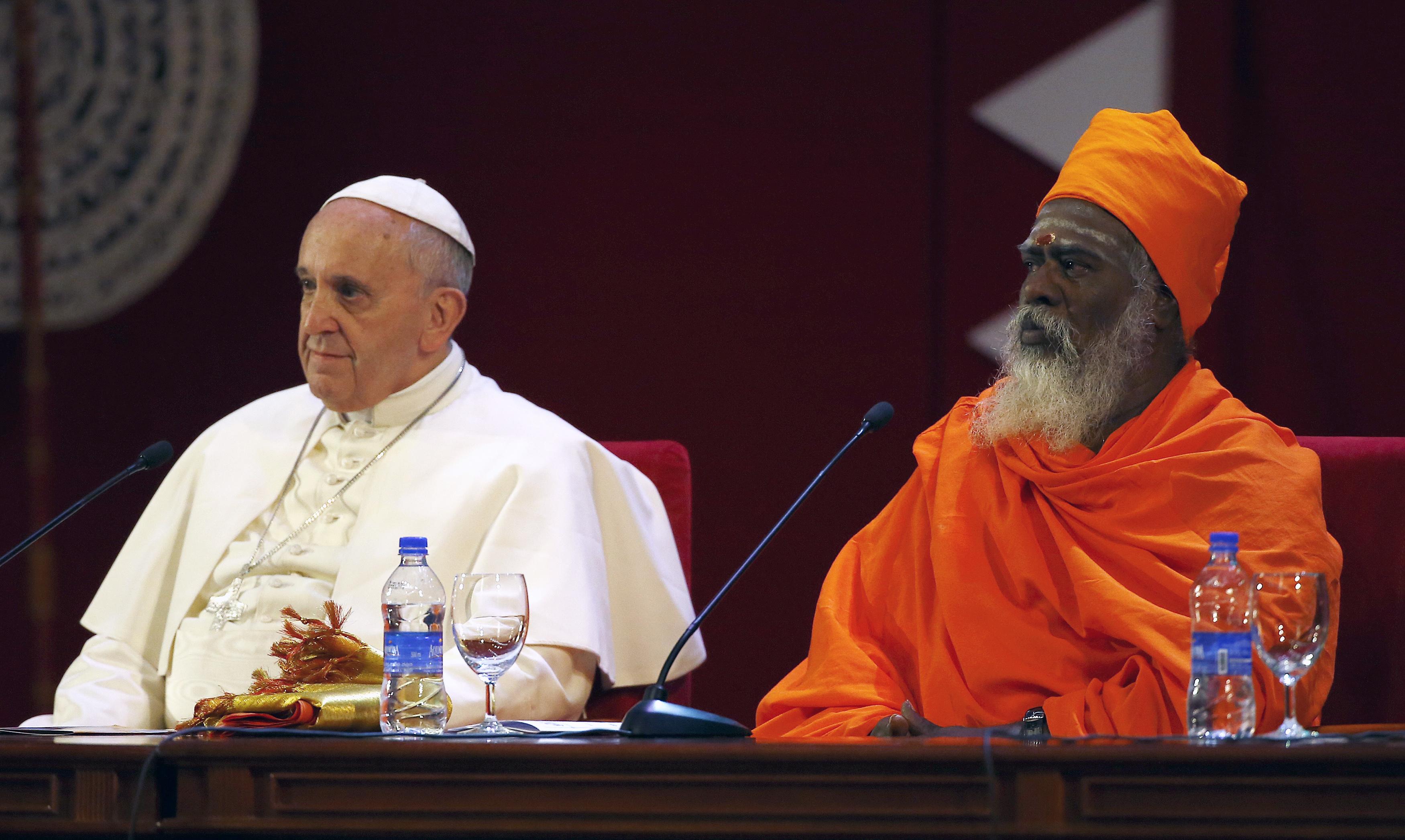 Pope Francis sits next to Hindu leader Ndu-Kurukkal SivaSri T. Mahadeva during the Interreligious Encounter in Colombo, Sri Lanka on January 13, 2015.