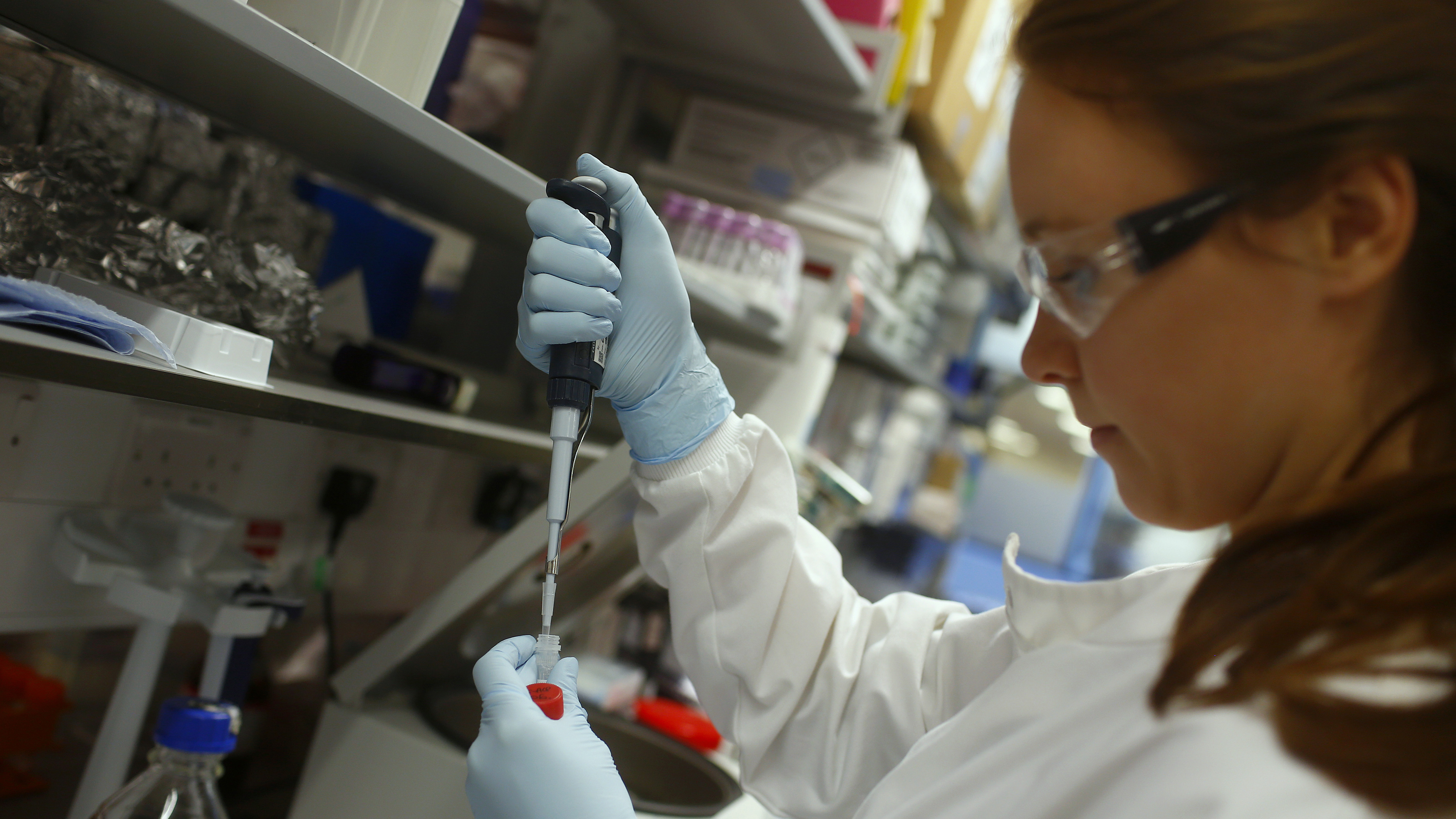 Research assistant Georgina Bowyer works on a vaccine for Ebola at the Jenner Institute in Oxford, England, on January 16, 2015.