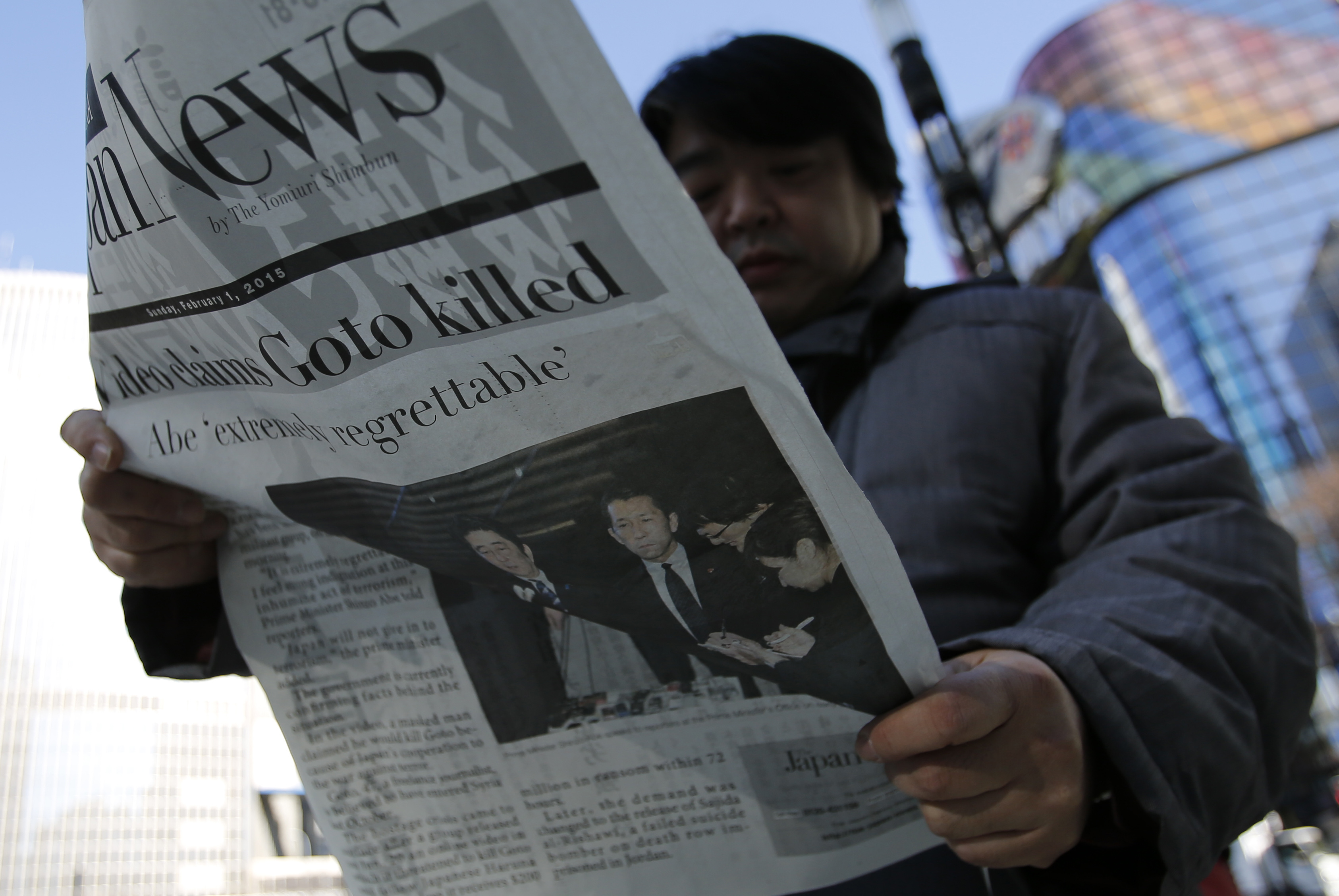 A man in Tokyo's Ginza district reads an extra edition of a newspaper, which reported ISIS' claim to have beheaded Japanese journalist Kenji Goto on February 1, 2015.