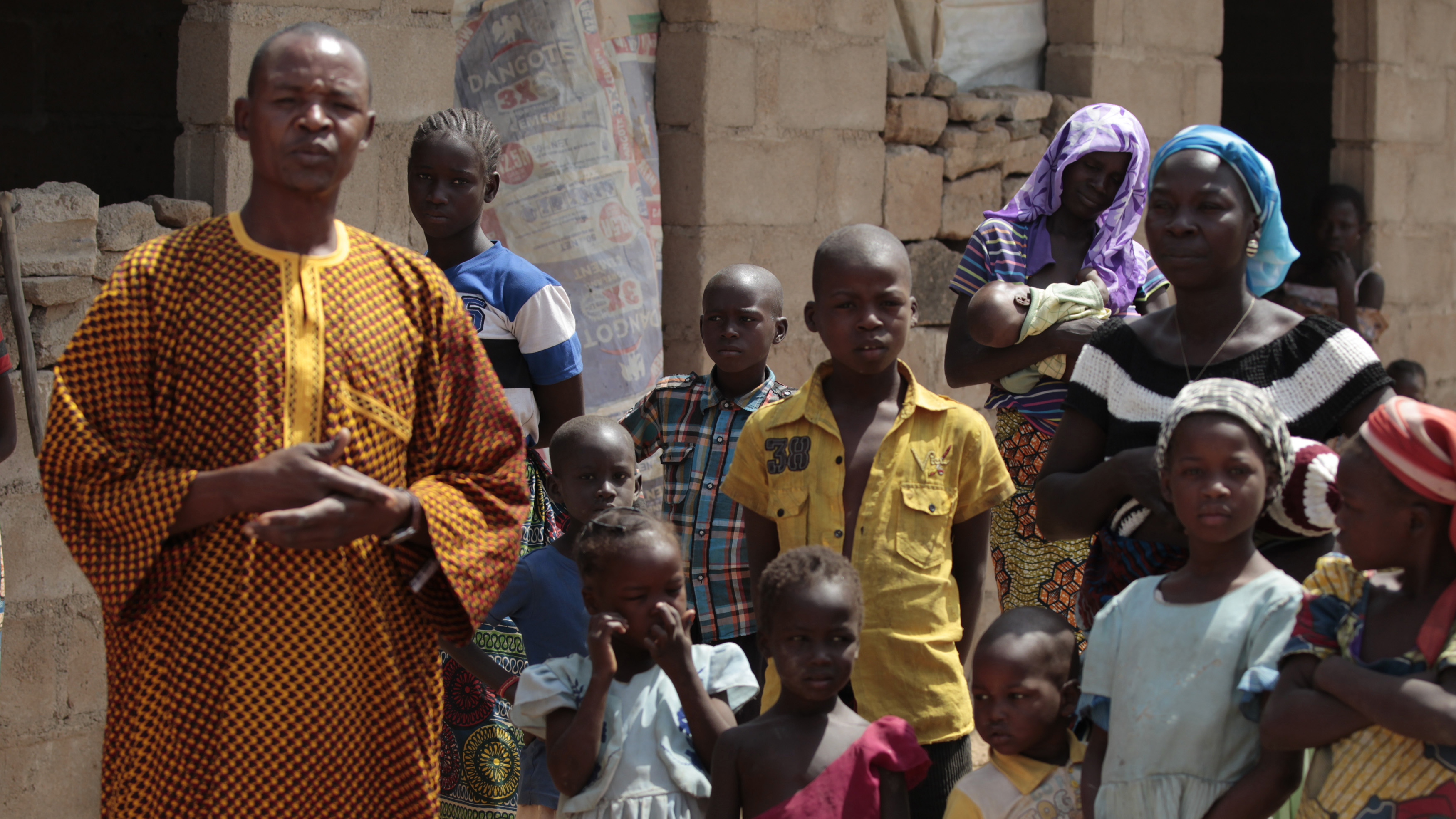 A family that escaped Boko Haram attacks in both Michika and Cameroon seek shelter in an uncompleted house in Adamawa on January 31, 2015.