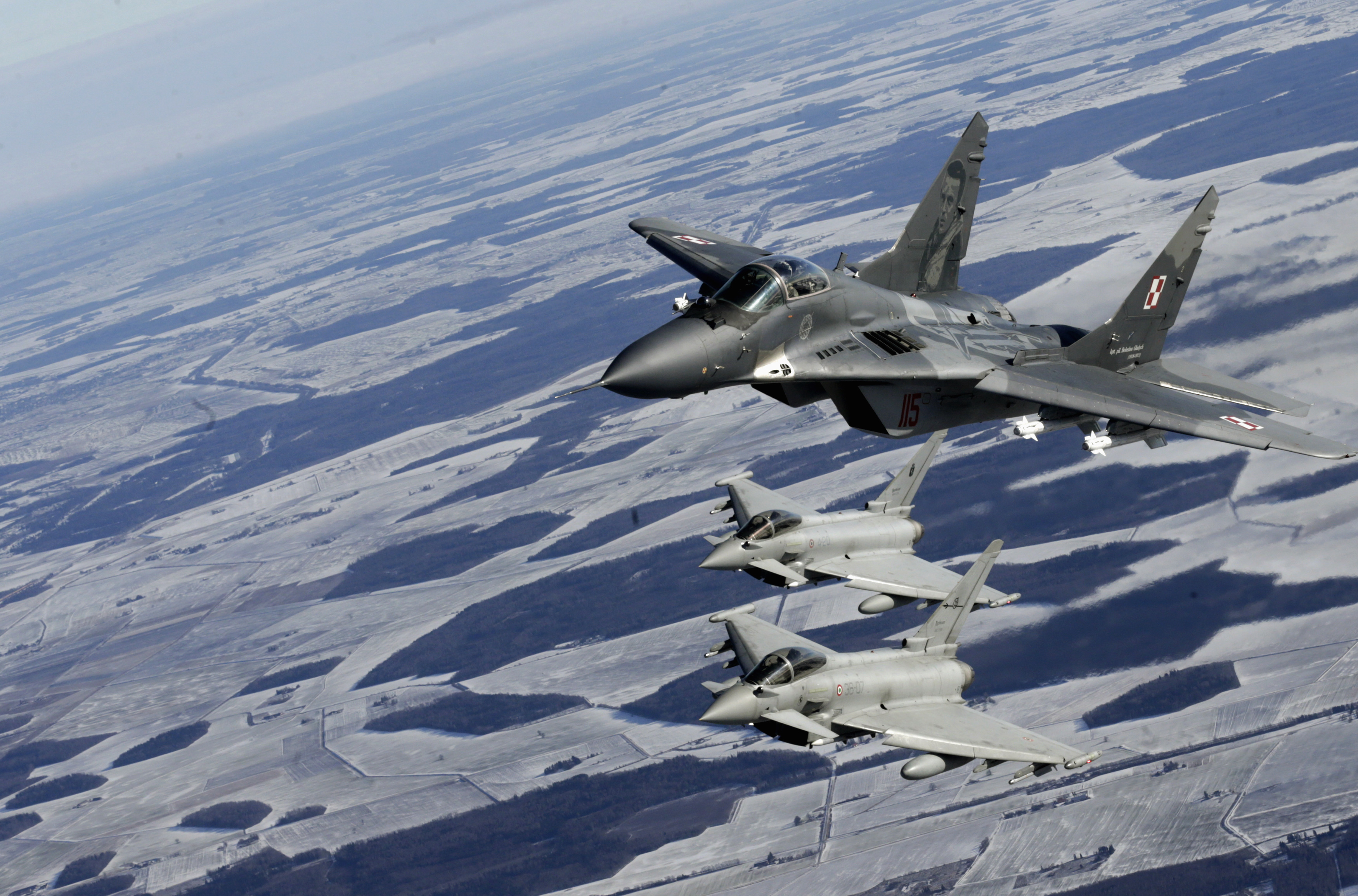 A Polish Air Force MIG-29 fighter and Italian Air Force Eurofighter Typhoon fighters participate during a NATO air policing mission patrol over the Baltics on February 10, 2015.
