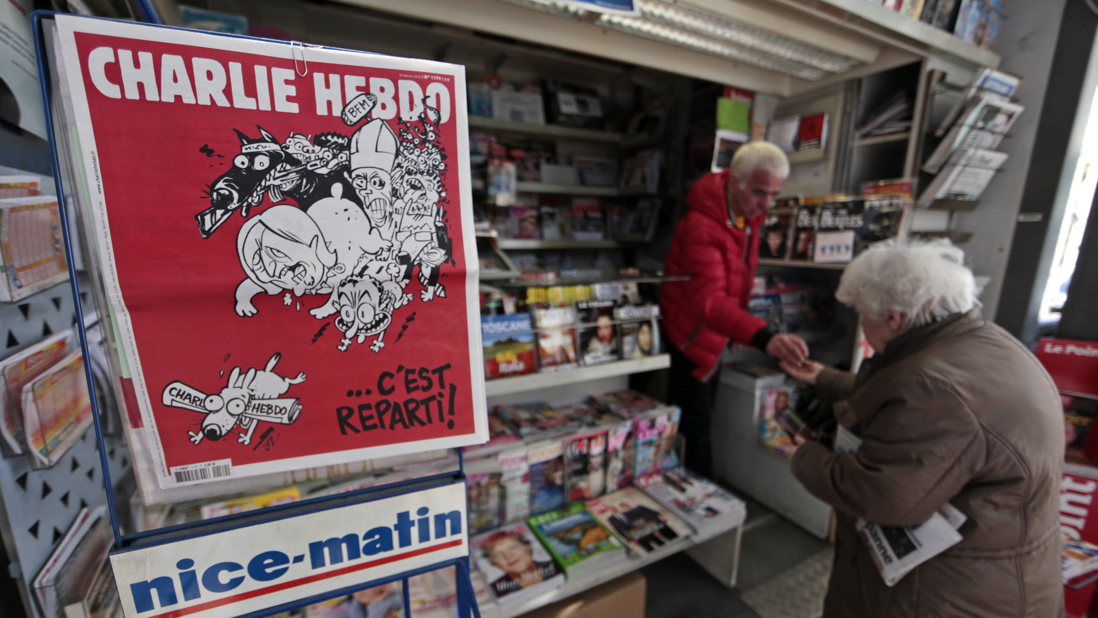 "The front page of satirical French weekly Charlie Hebdo, entitled ""C'est Reparti"" (""Here we go again"") is displayed at a kiosk in Nice on February 25, 2015."