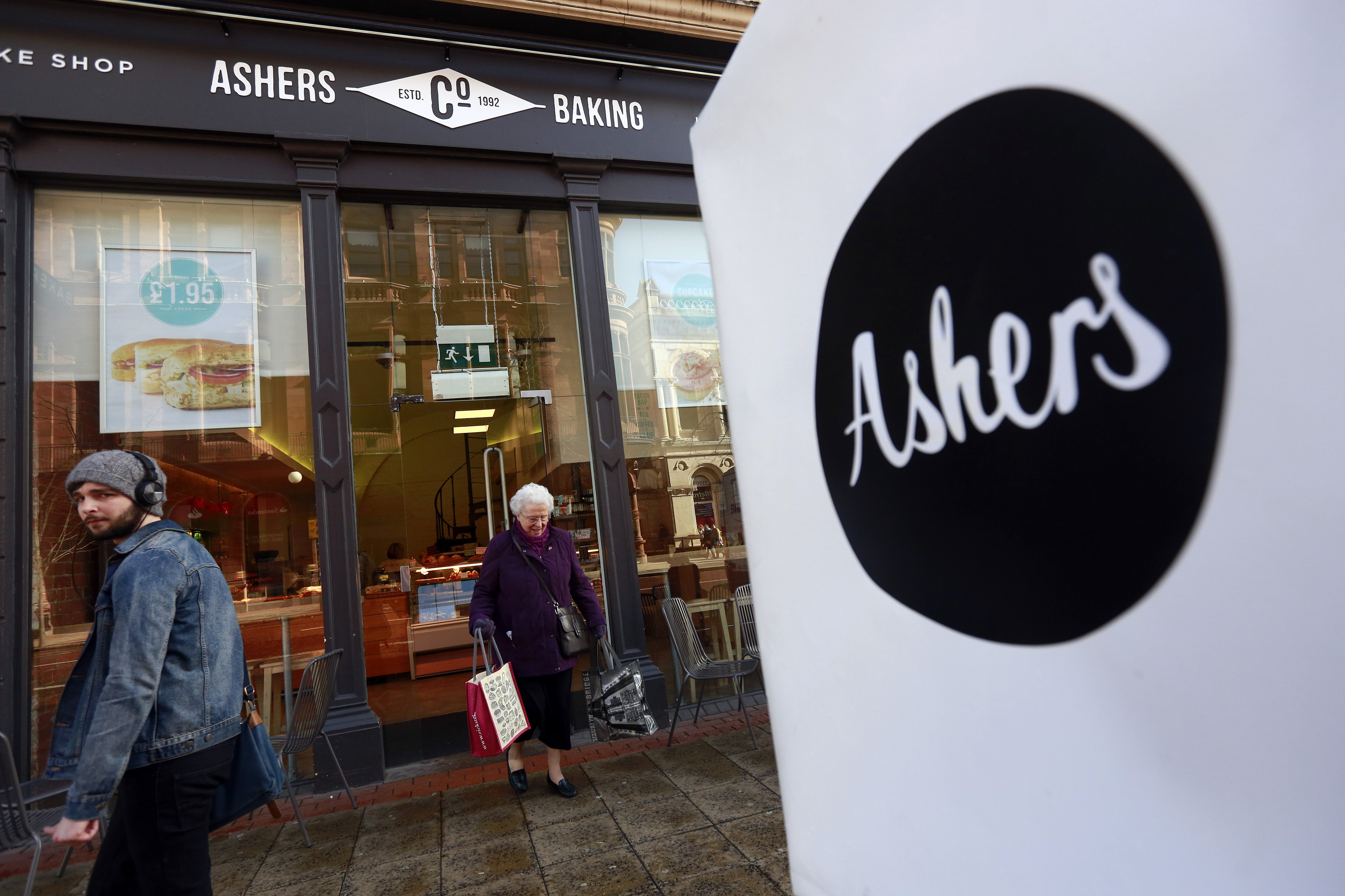 A woman leaves Ashers bakery in Belfast, Nothern Ireland, on March 26, 2015. Ashers will face a discrimination case from the Equality Commission after it refused to make a cake bearing a pro-gay marriage slogan.