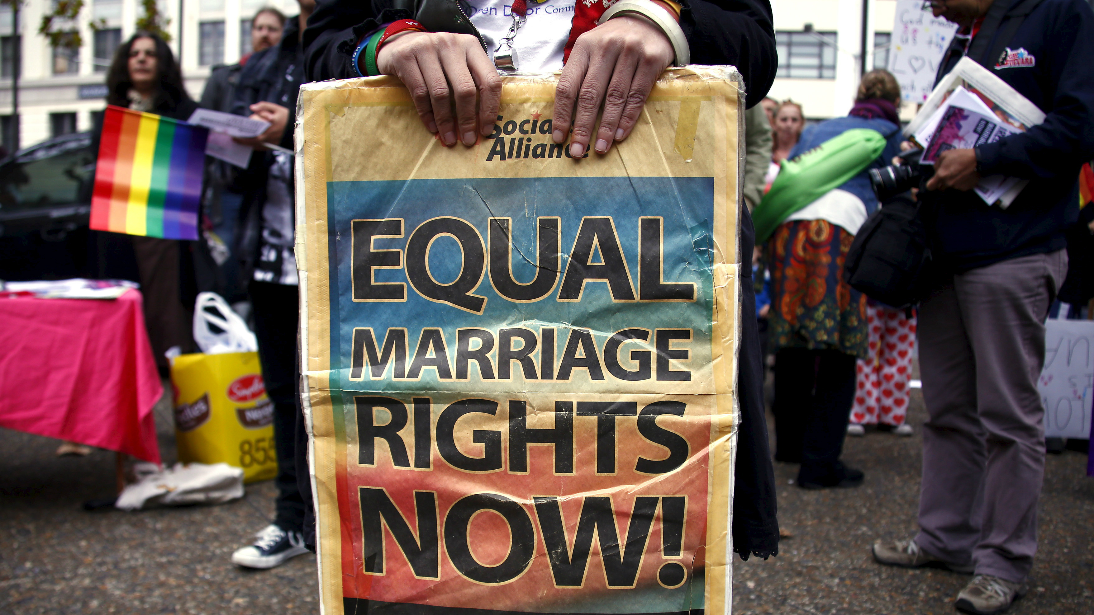 A gay rights activist holds a placard during a rally supporting same-sex marriage, in Sydney, Australia, May 31, 2015.