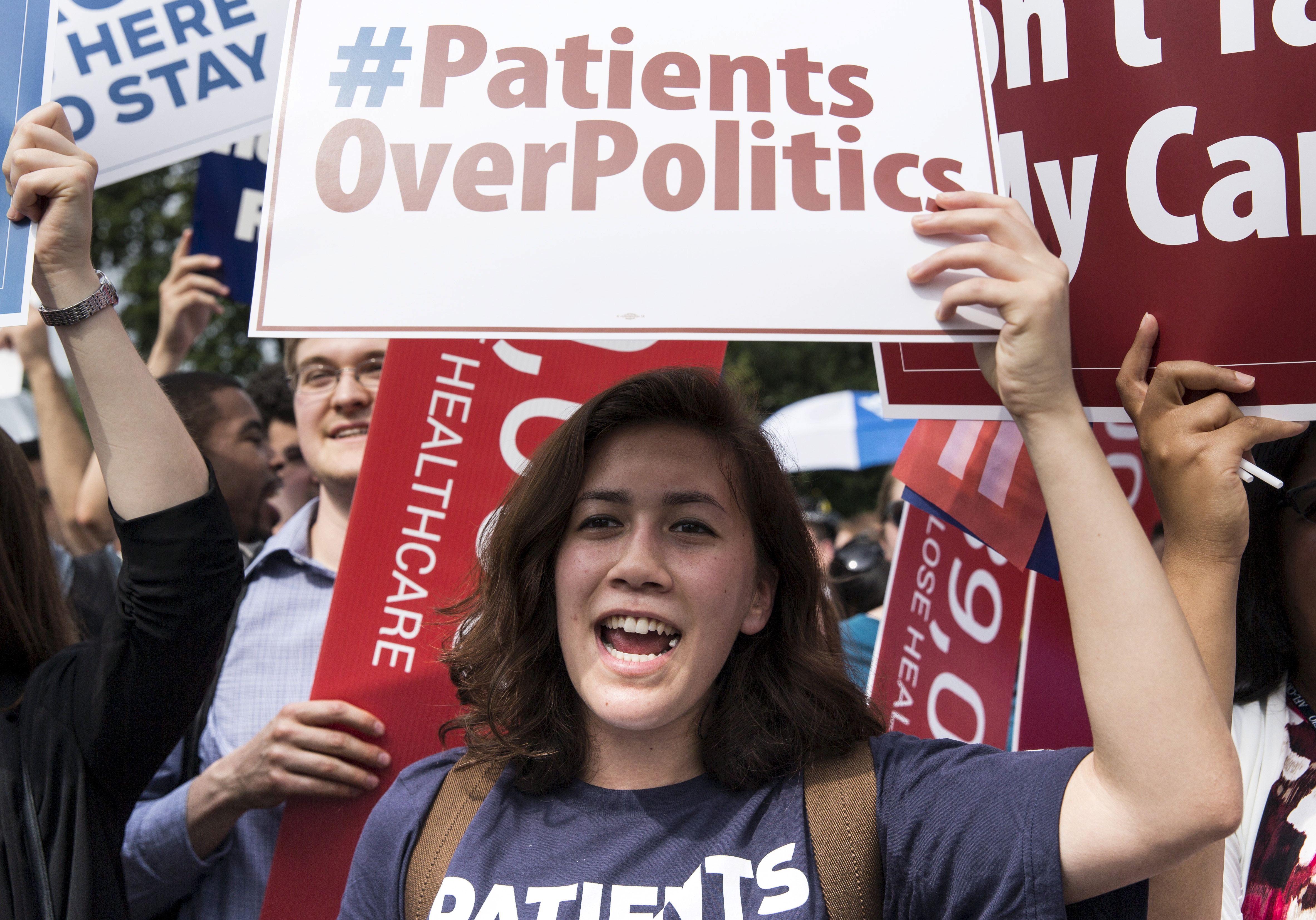 A supporter of the Affordable Care Act celebrates last week after the Supreme Court upheld the law in a 6-3 vote. The Court upheld the nationwide availability of tax subsidies that are crucial to the law's implementation.