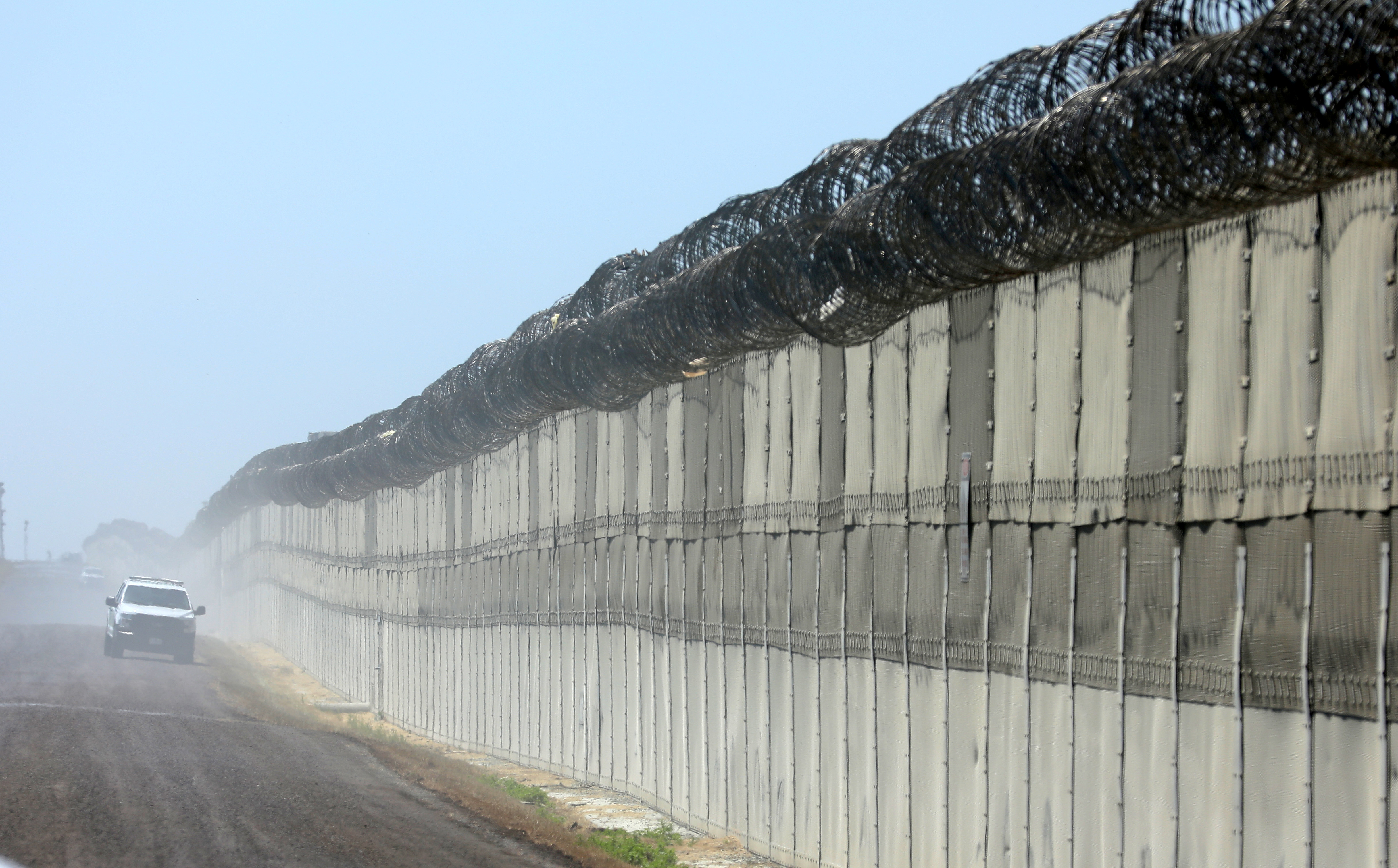 A U.S. Customs and Border Patrol officer patrols along the secondary fence between the U.S. and Mexico in San Diego, California, U.S. April 21, 2017.