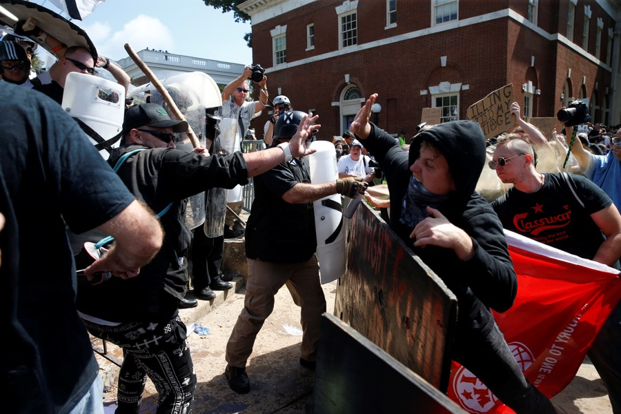 Members of white nationalists clash against a group of counter-protesters in Charlottesville, Virginia