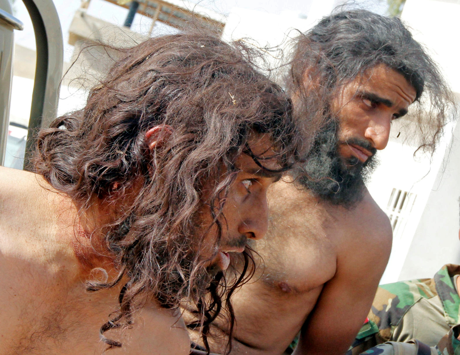 Captives suspected of being Islamic State militants are seen southwest of Kirkuk, Iraq.