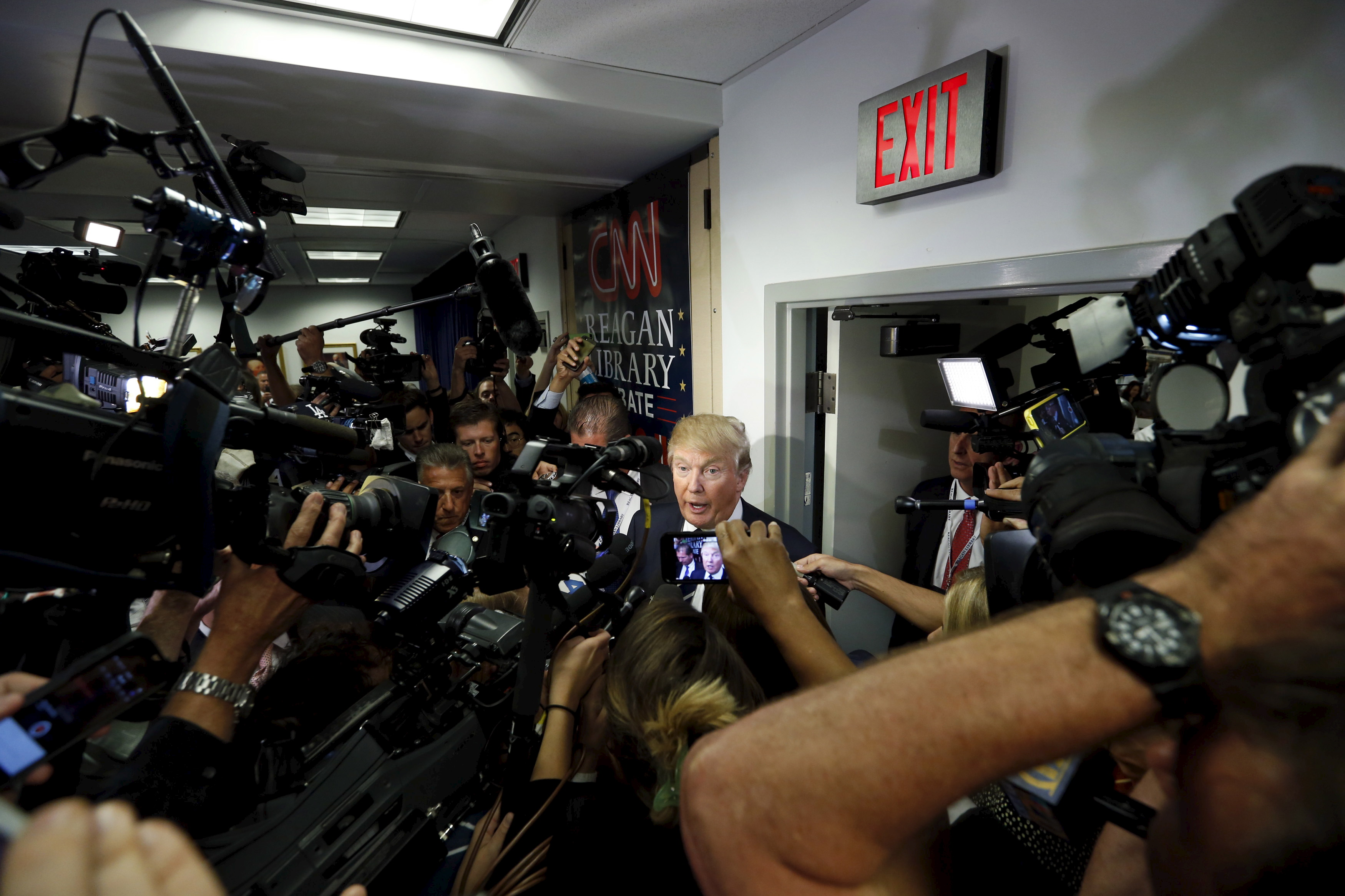Donald Trump talks to members of the press after the second official Republican presidential candidates debate of the 2016 U.S. presidential campaign at the Ronald Reagan Presidential Library in Simi Valley, California, September 16, 2015.