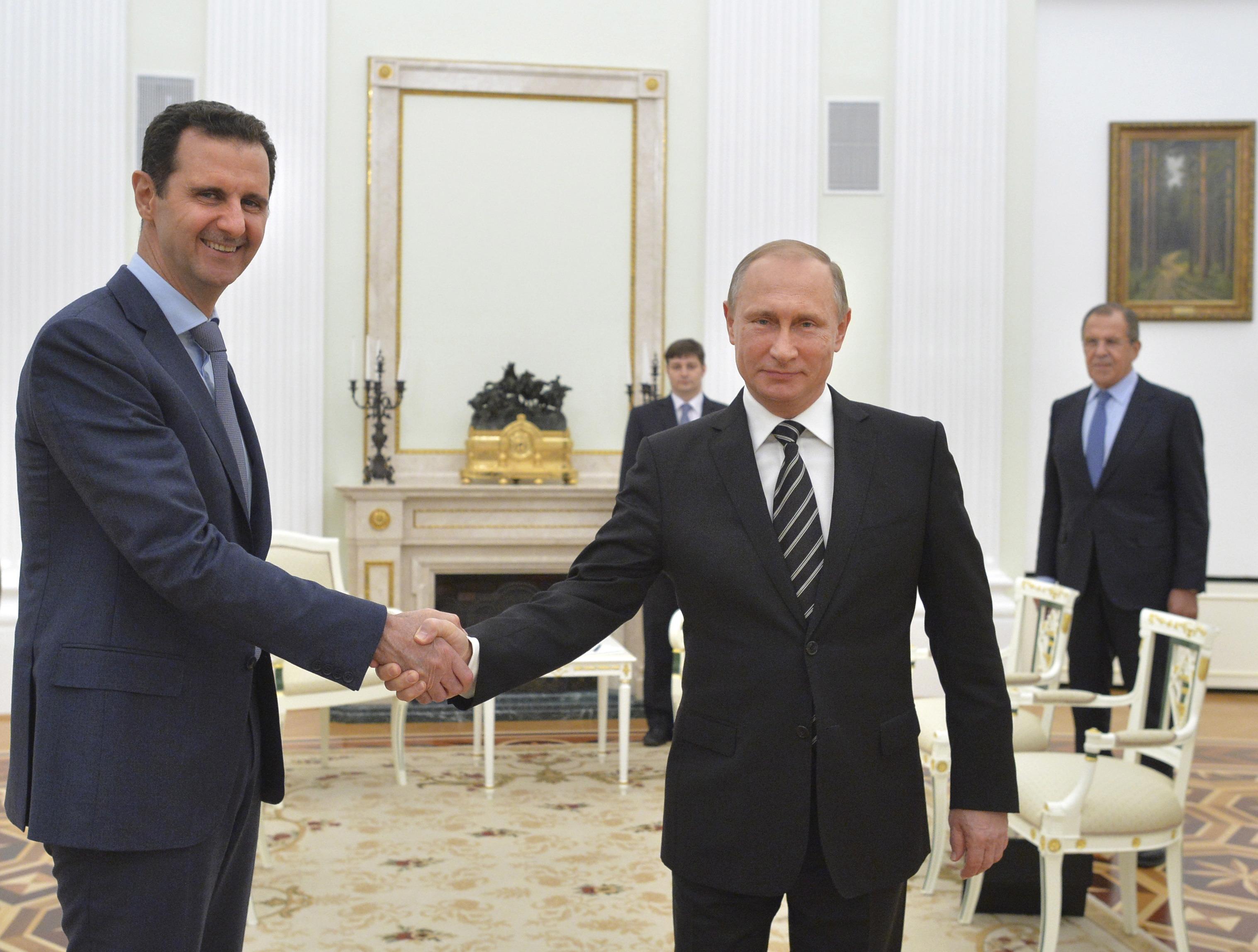 Russian President Vladimir Putin and Syrian President Bashar al-Assad meet at the Kremlin in Moscow, Russia.