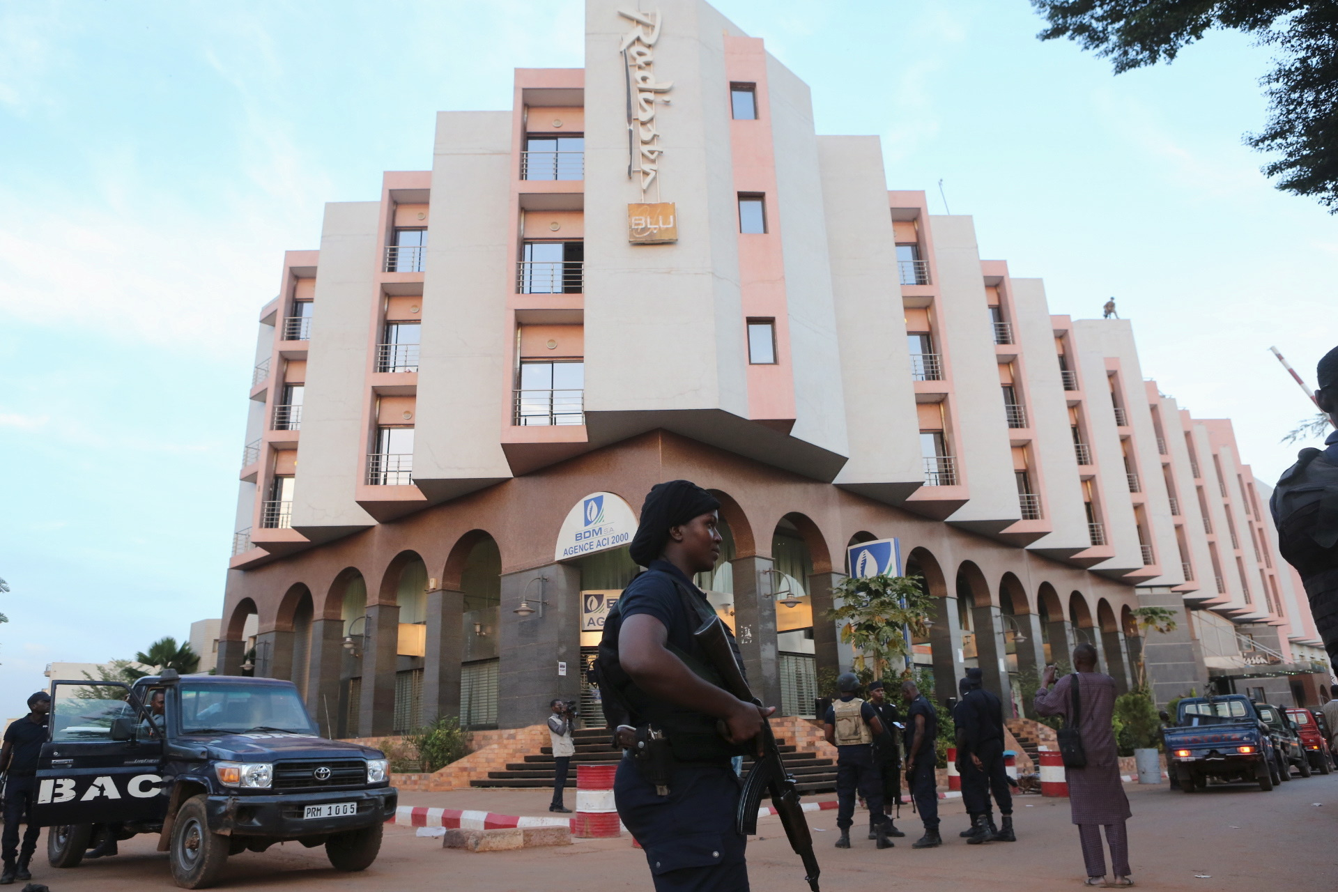 A Malian police officer stands guard in front of the Radisson hotel in Bamako, Mali, November 20, 2015.