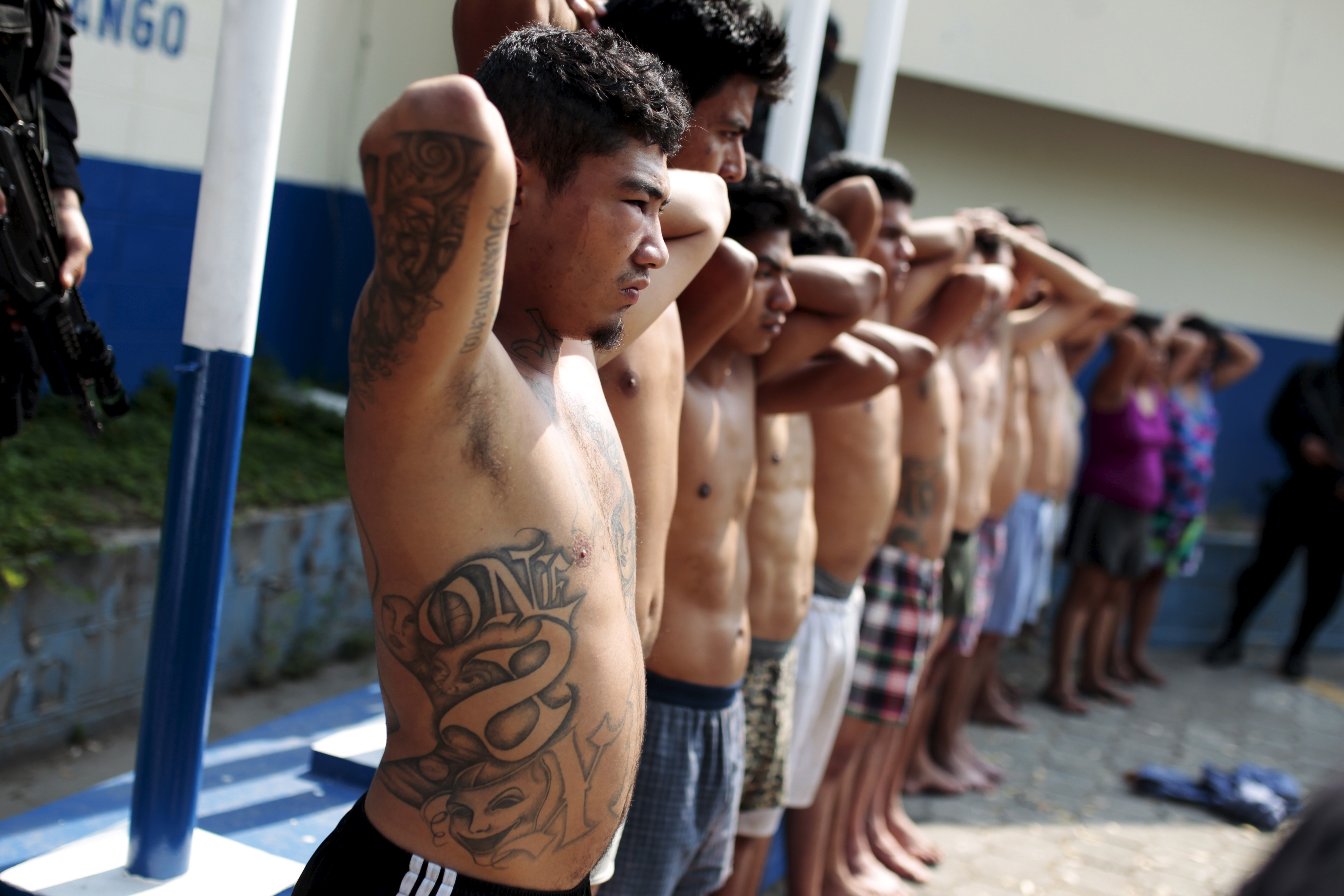 13 suspected members of the 18th street gang are presented to the media after being arrested by the police in Soyapango, El Salvador in March.