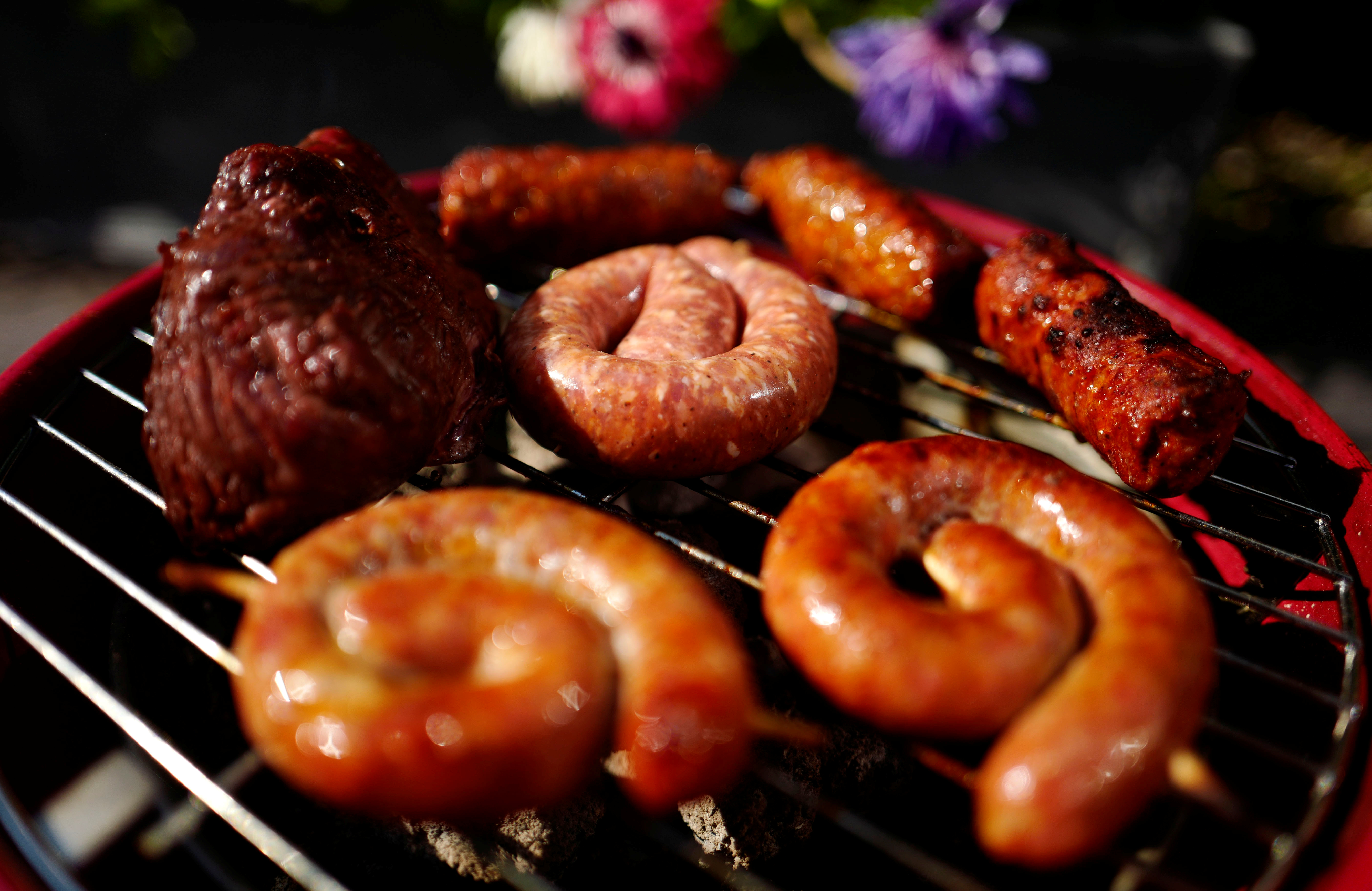 Sausages and meat grill on a charcoal barbecue in a garden in Hanau near Frankfurt, Germany, June 7, 2016.