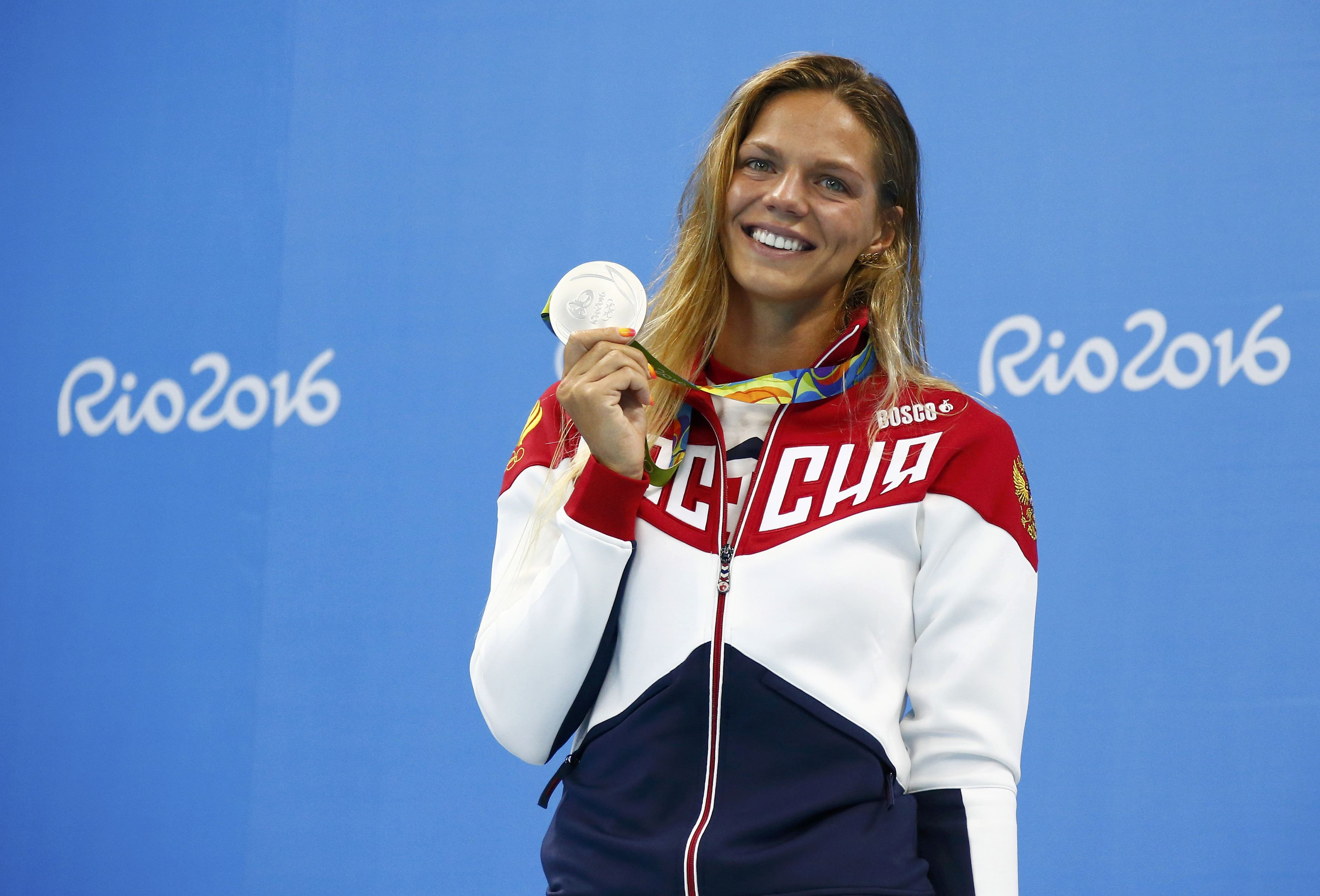 Yulia Efimova (RUS) of Russia poses with her silver medal at the Rio Olympics.