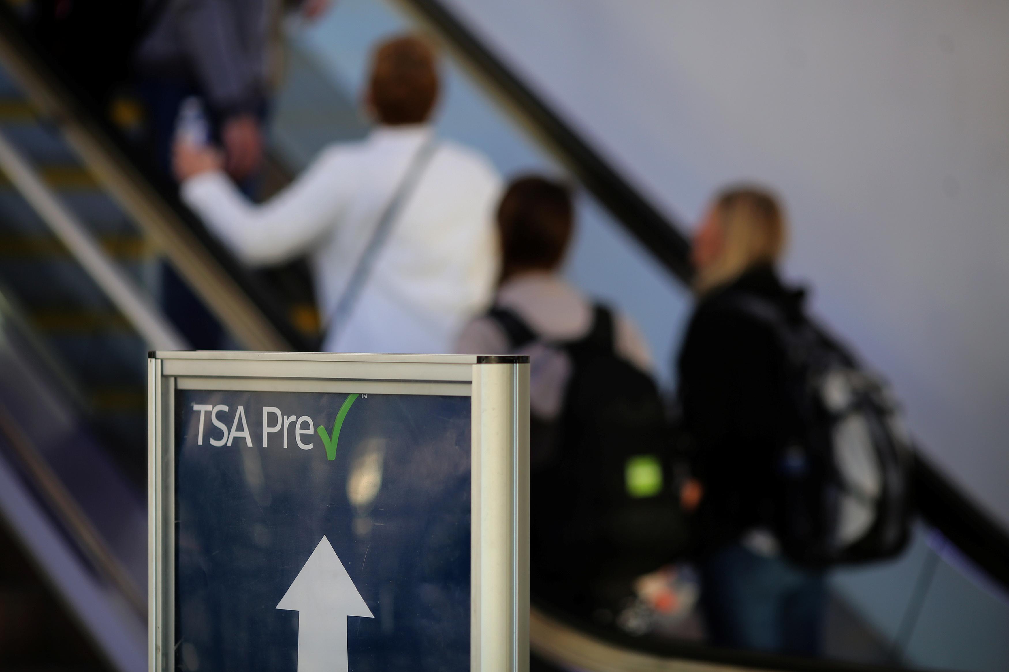 TSA Pre-check sign in front of escalator