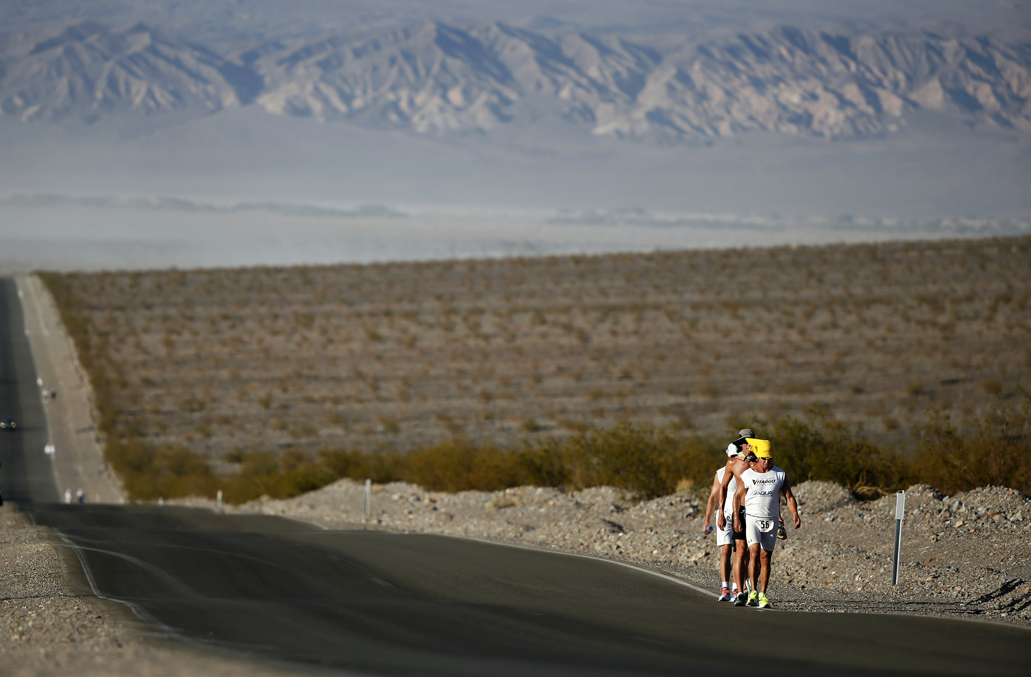 Competitors run in the 2013 Badwater Ultramarathon in Death Valley National Park, California. The 135-mile (217 km) race, which bills itself as the world's ...