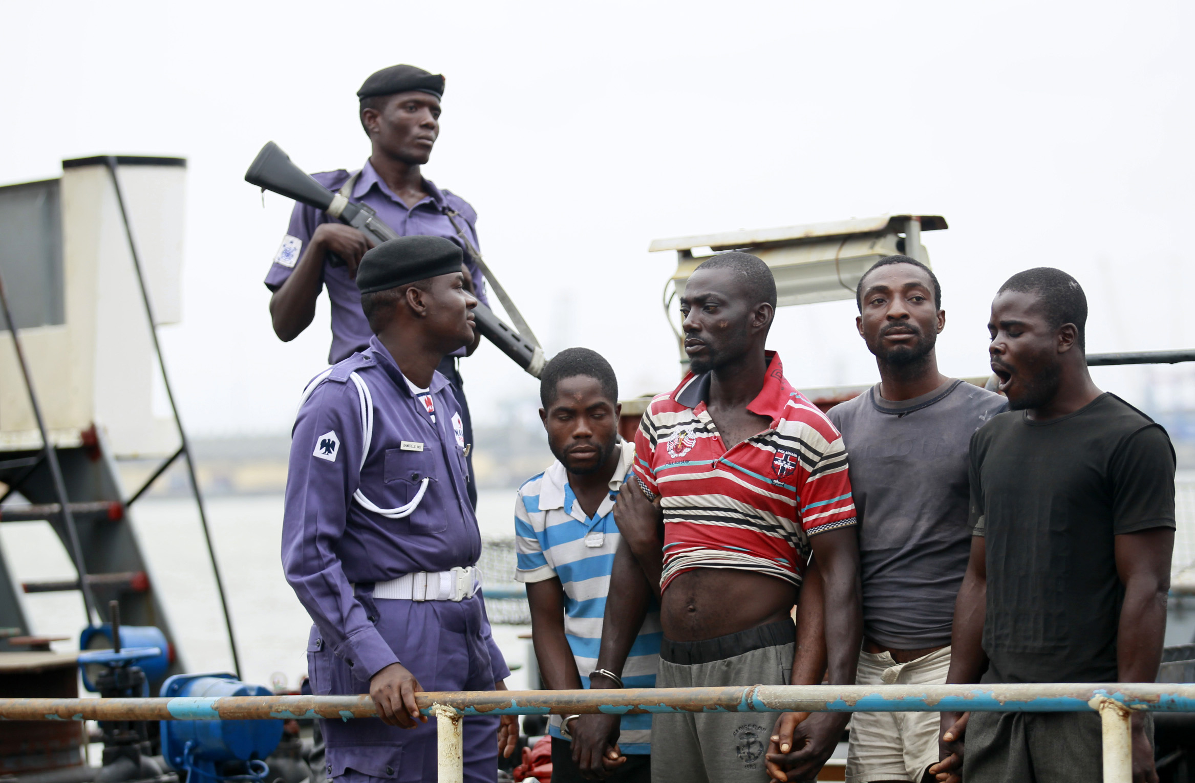 Suspected pirates are paraded aboard a ship at a Lagos naval base after their arrest by Nigerian authorities.