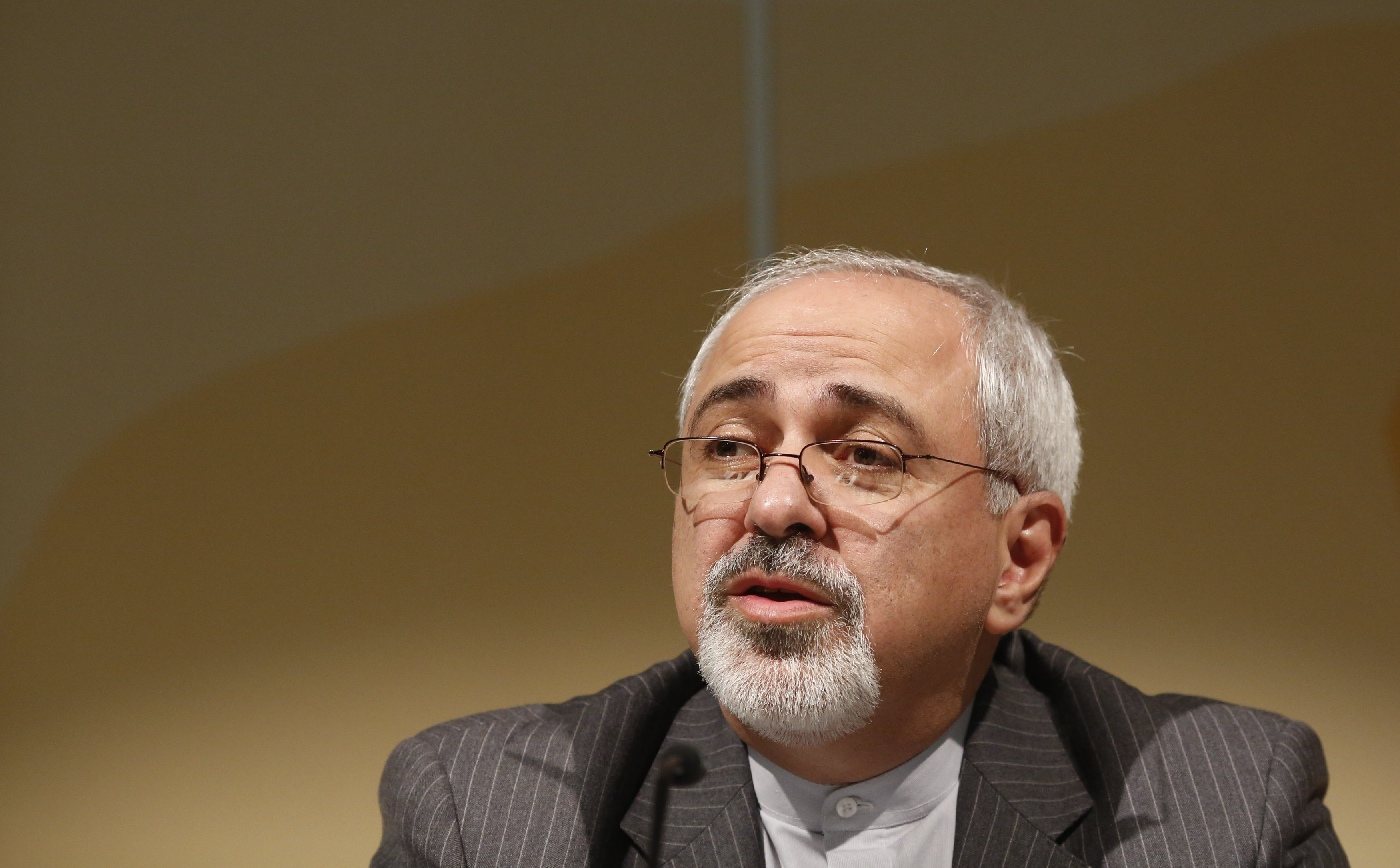Iranian Foreign Minister Mohammad Javad Zarif addresses a news conference in Geneva
