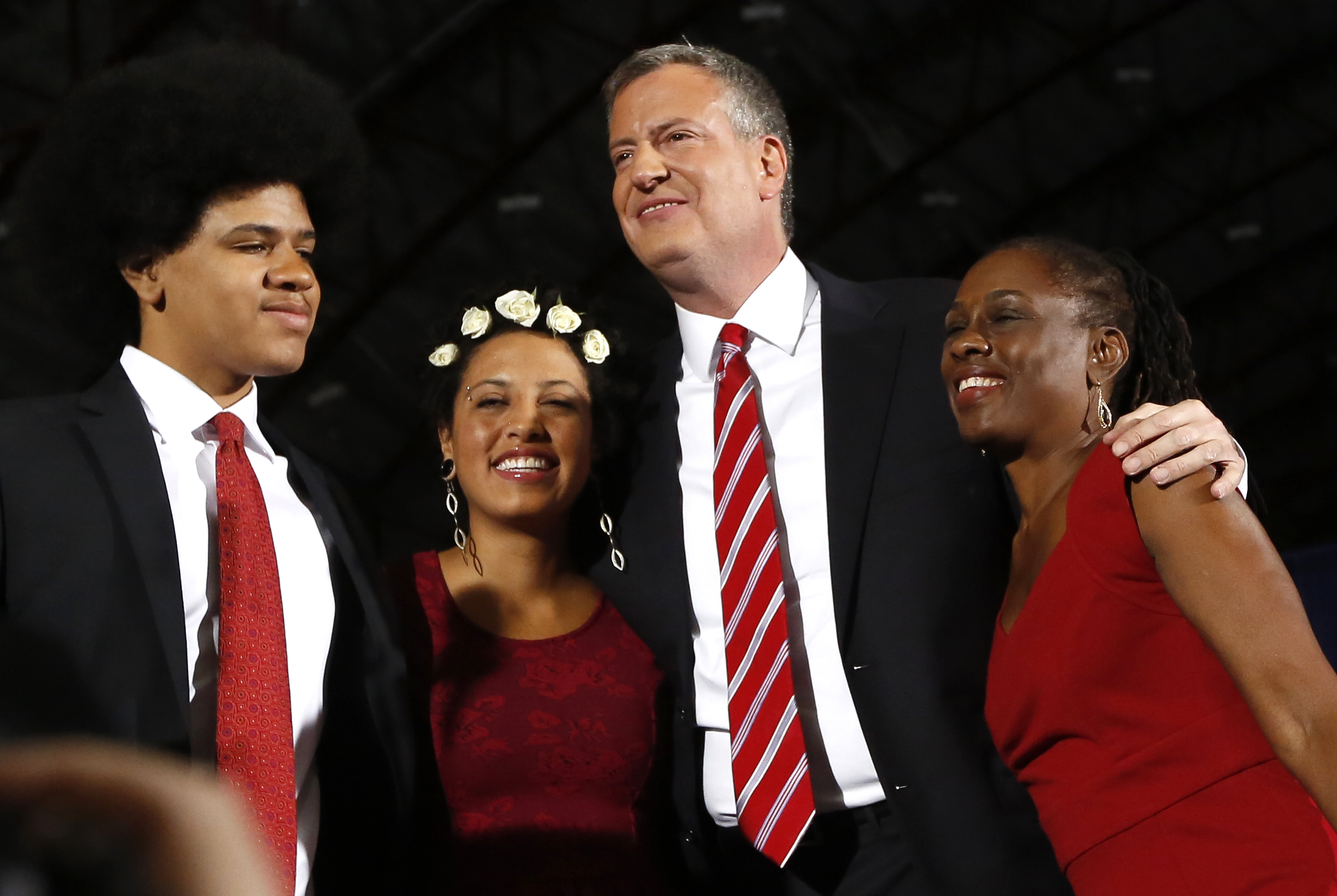 Democrat Bill de Blasio (2nd R) hugs his wife Chirlane McCray (R) and children Chiara and Dante
