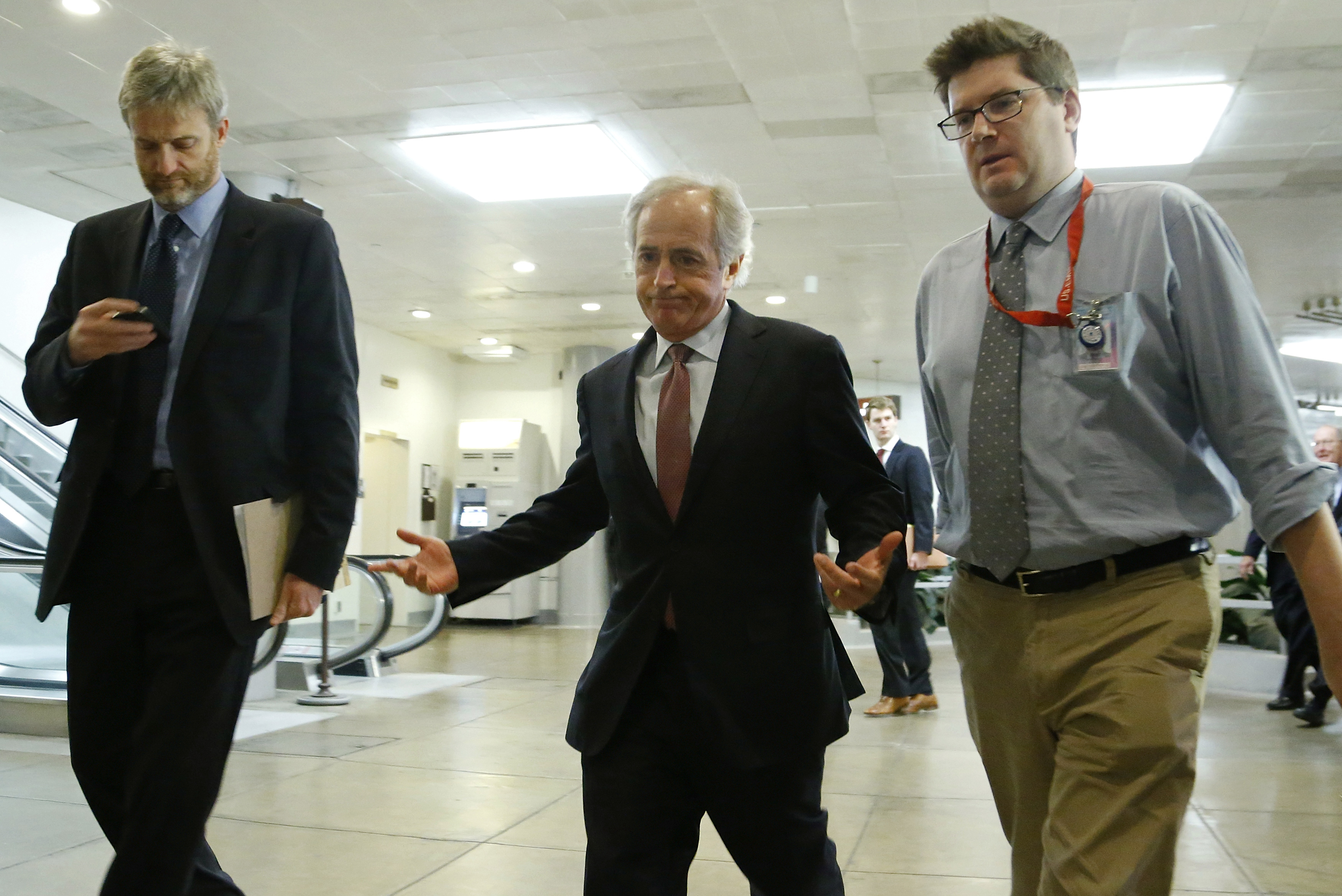 Senator Bob Corker (R-Tenn.) shrugs at a question from reporters as he walks to a closed-door briefing on talks with Iran in 2013. Corker is a leading proponent of raising gas taxes to boost the nearly-dry Highway Trust Fund.