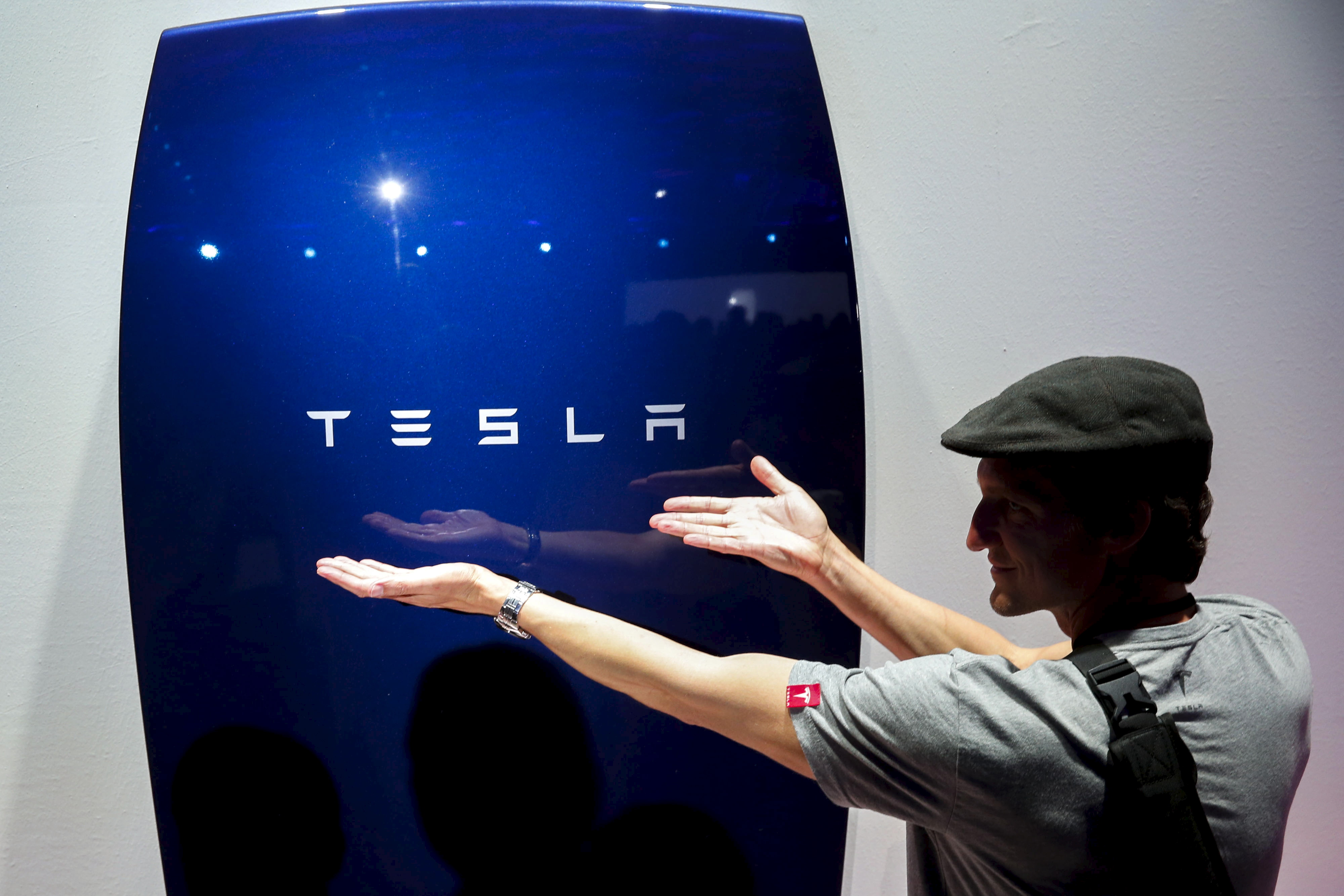 Attendees take pictures of the new Tesla Energy Powerwall Home Battery during an event at Tesla Motors in Hawthorne, California, on April 30, 2015.