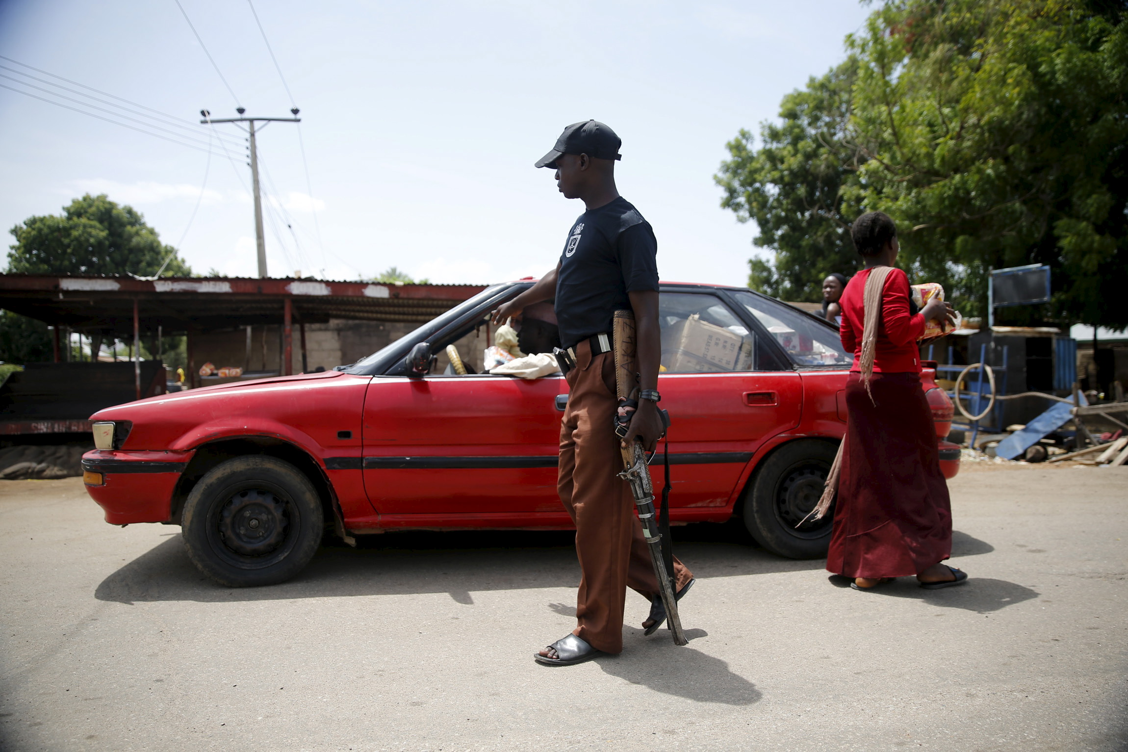 A local vigilante checks a vehicle at a check point in Michika town, after the Nigerian military recaptured it from Boko Haram, in Adamawa state May 10, 2015.