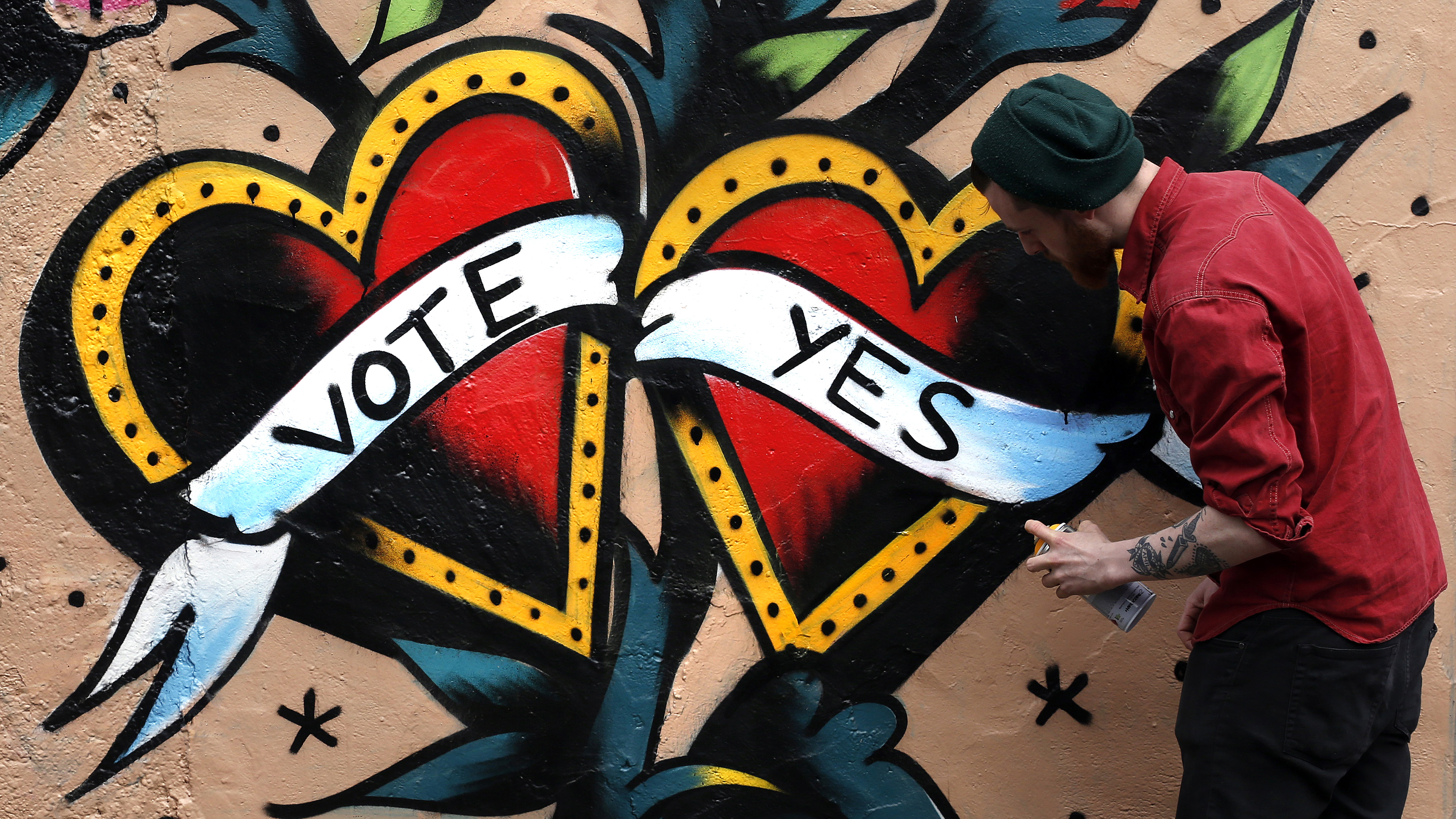 A graffiti artist finishes a Yes campaign piece in central Dublin on May 20, 2015. Irish Prime Minister Enda Kenny said that Ireland must seize its opportunity to become the first country to approve same-sex marriage in a popular vote when it holds a refe