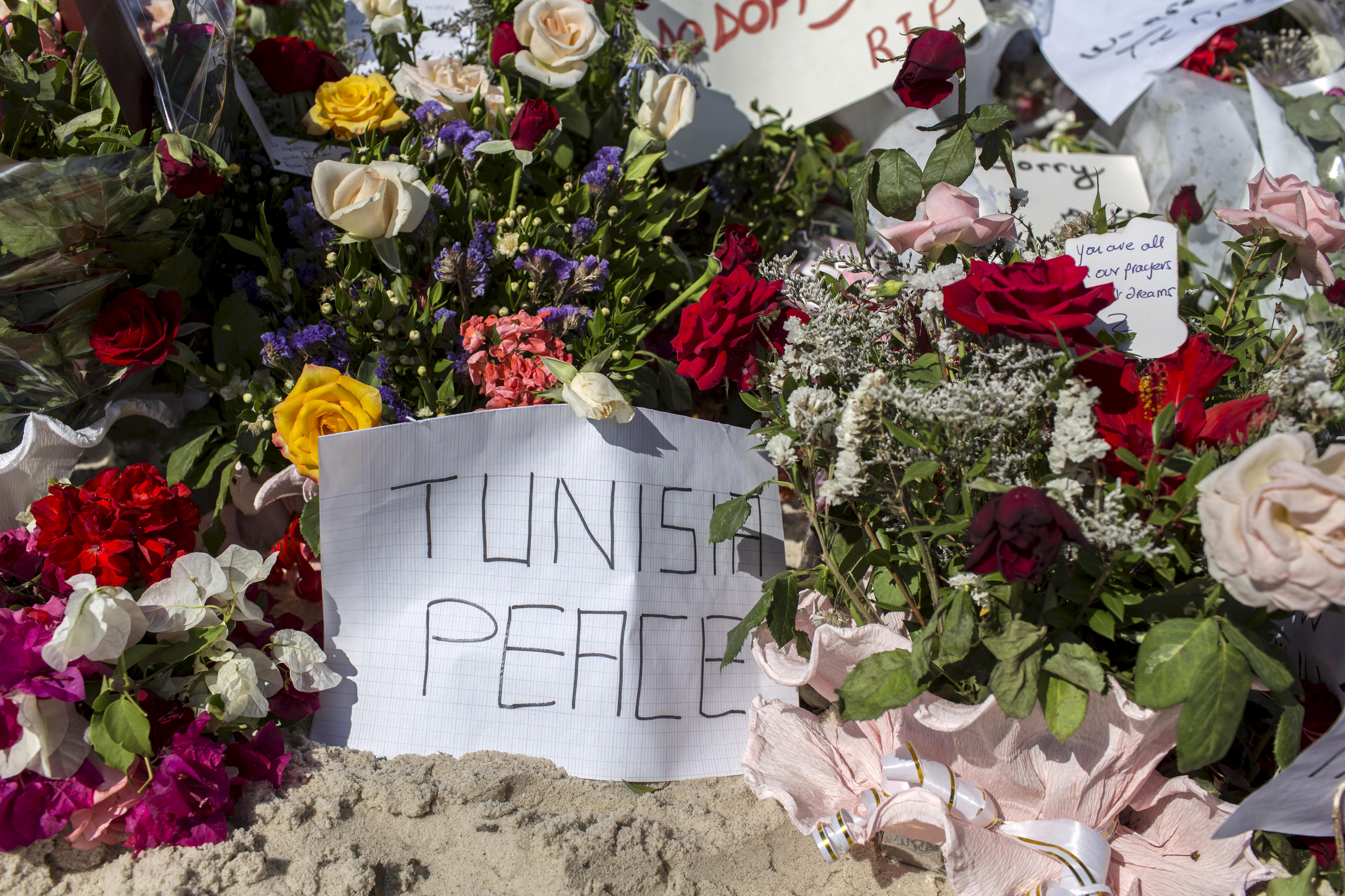 Messages And Flowers Are Placed At The Beach Of Imperial
