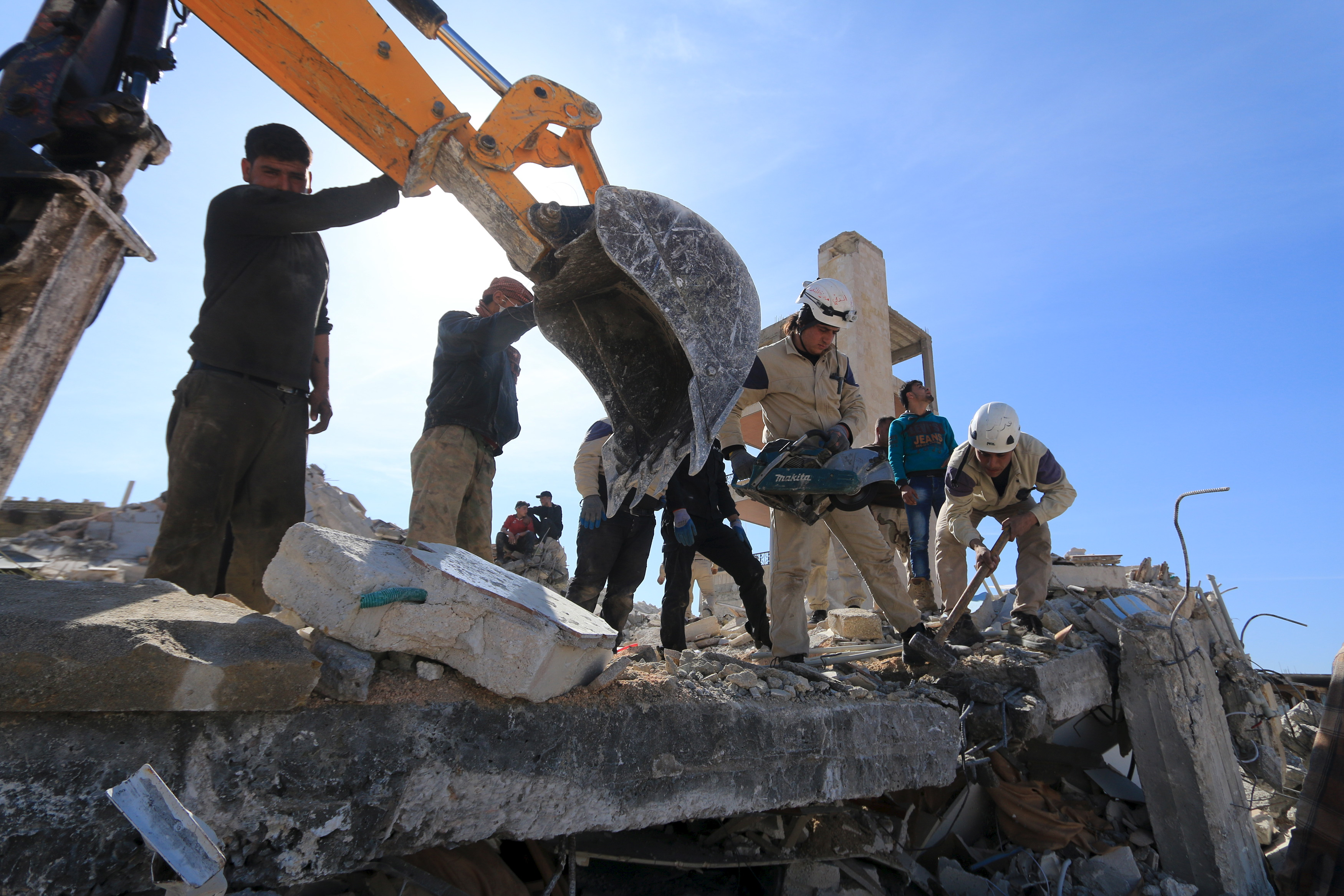 People and Civil Defense members remove rubble while looking for survivors in the ruins of a destroyed Medecins Sans Frontieres (MSF) supported hospital hit by missiles in Marat Numan, Idlib province, Syria, February 16, 2016.