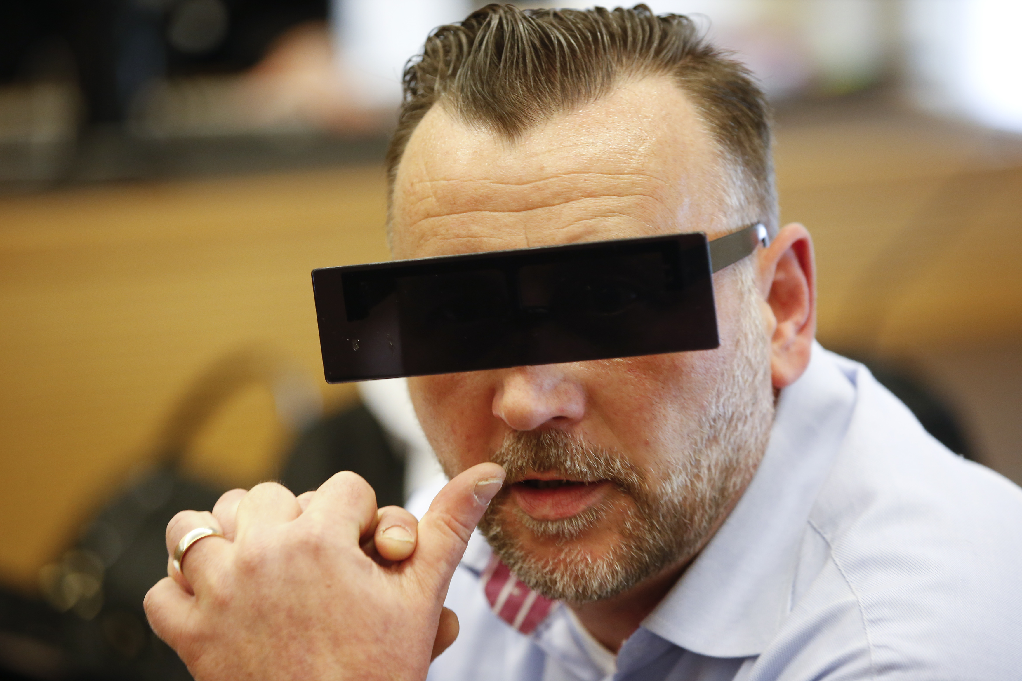 Lutz Bachmann, co-founder of Patriotic Europeans Against the Islamisation of the West (PEGIDA), waits in a courtroom for his trial to be charged with incitement over Facebook posts in a court in Dresden, Germany, April 19, 2016.