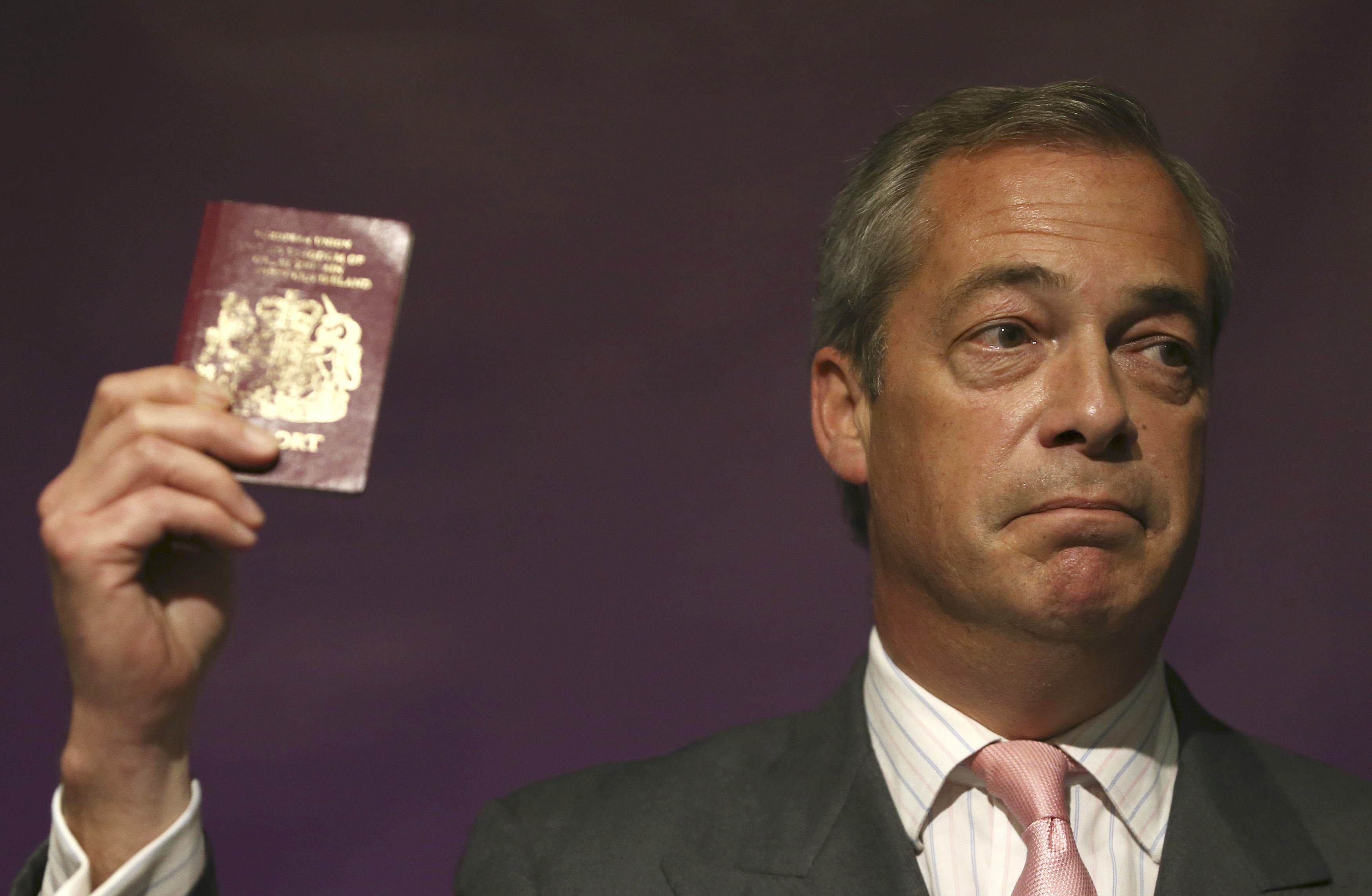 Leader Of The Uk Independence Party Nigel Farage Holds His Passport As He  Speaks At A Probrexit Event In London On June 3