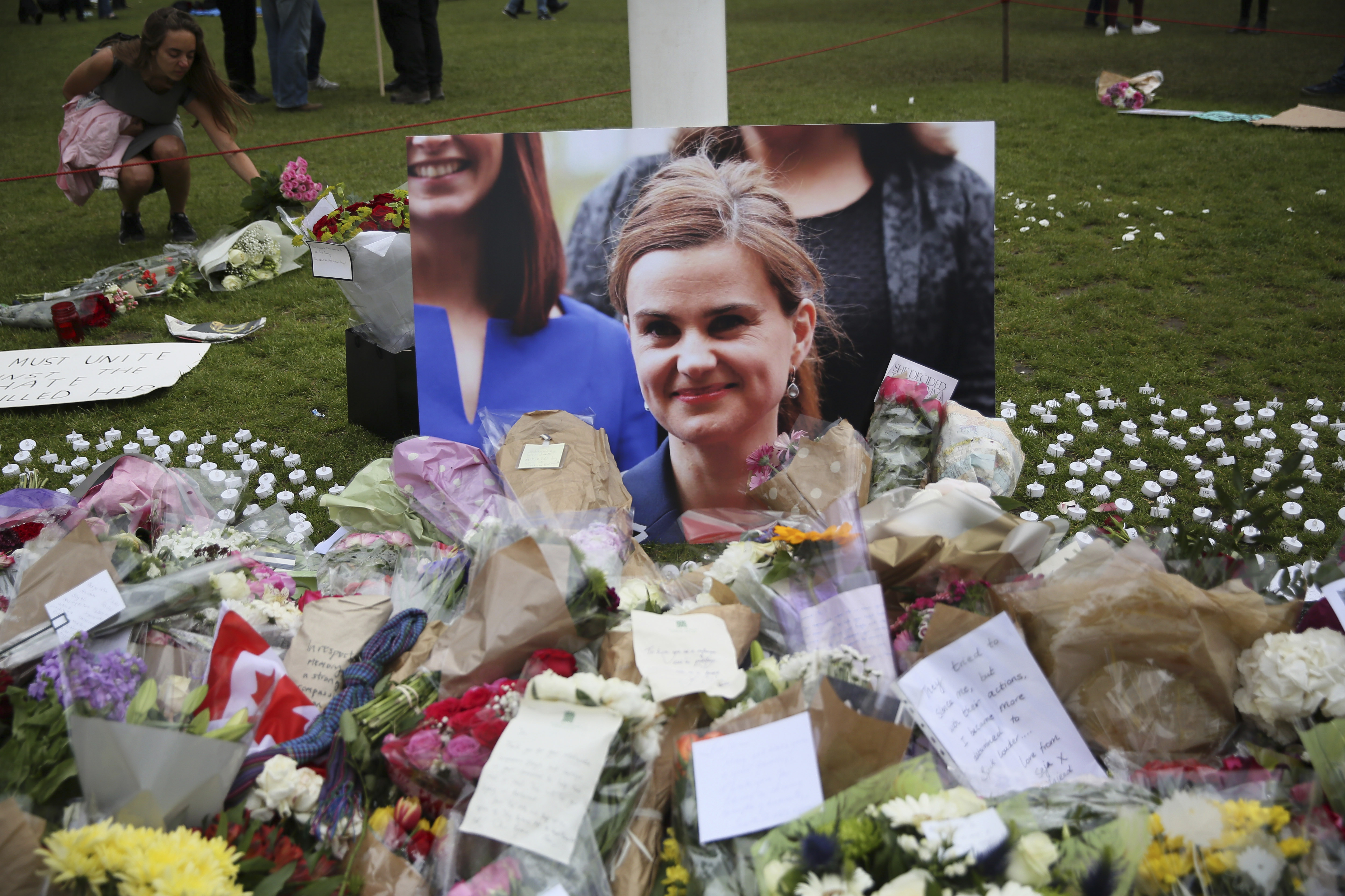 Tributes in memory of murdered Labour Party MP Jo Cox, who was shot dead in Birstall, are left at Parliament Square in London,