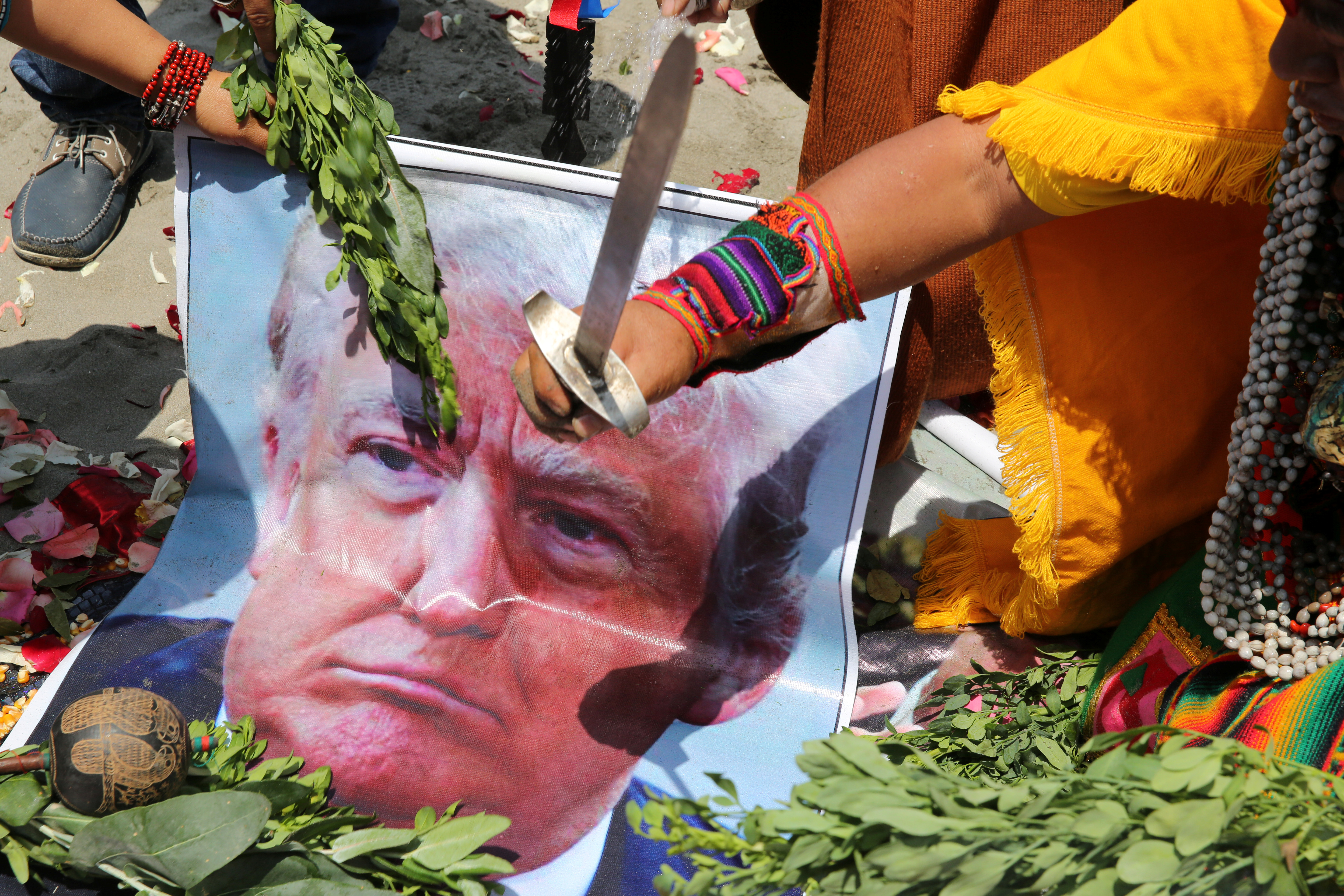 Peruvian shamans with poster of US Republican presidential candidate Donald Trump perform a ritual of predictions ahead of the US presidential elections, in Lima, Peru November 7, 2016.