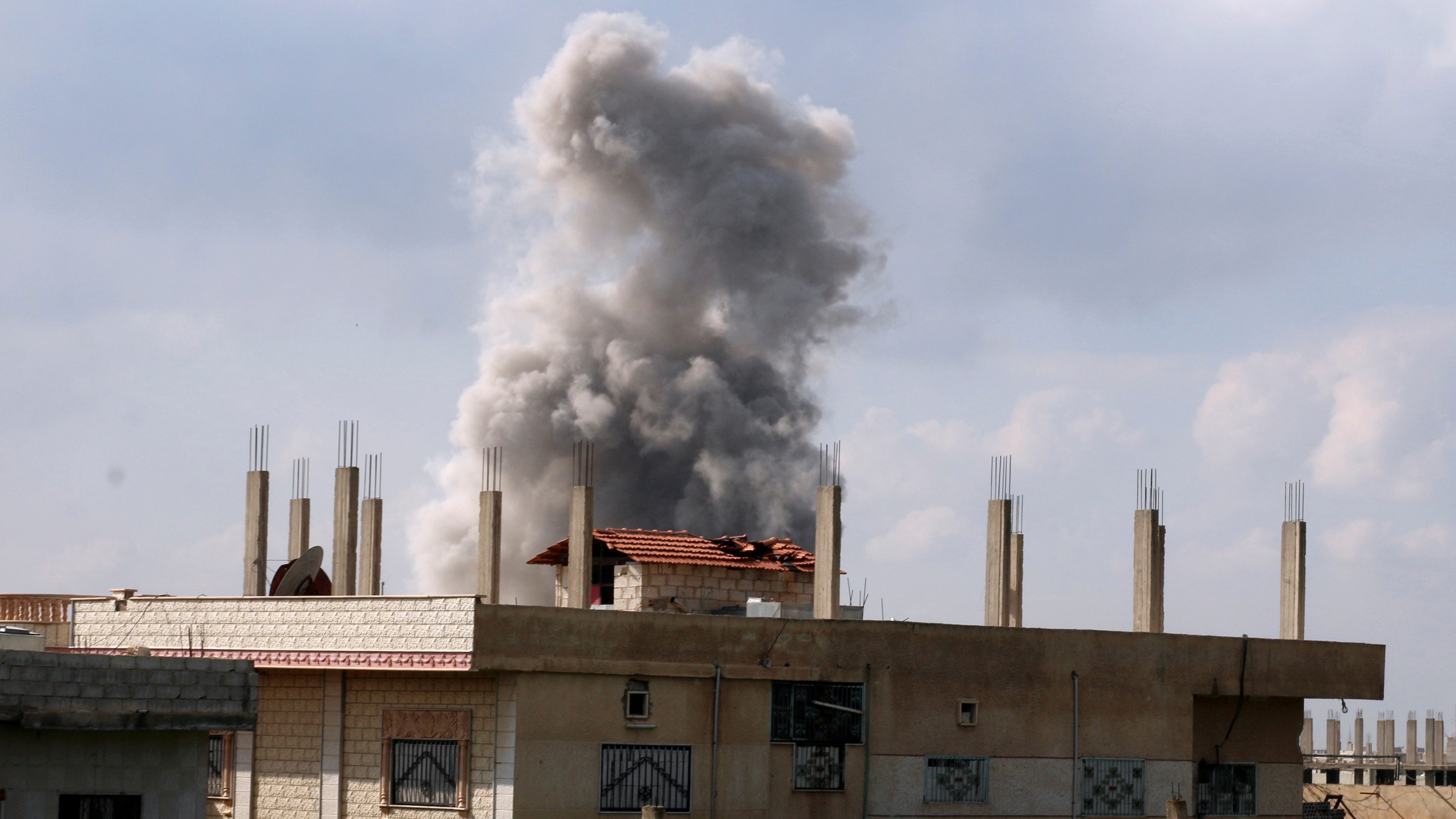 Smoke rises after an airstrike on a rebel-held area, April 7th 2017