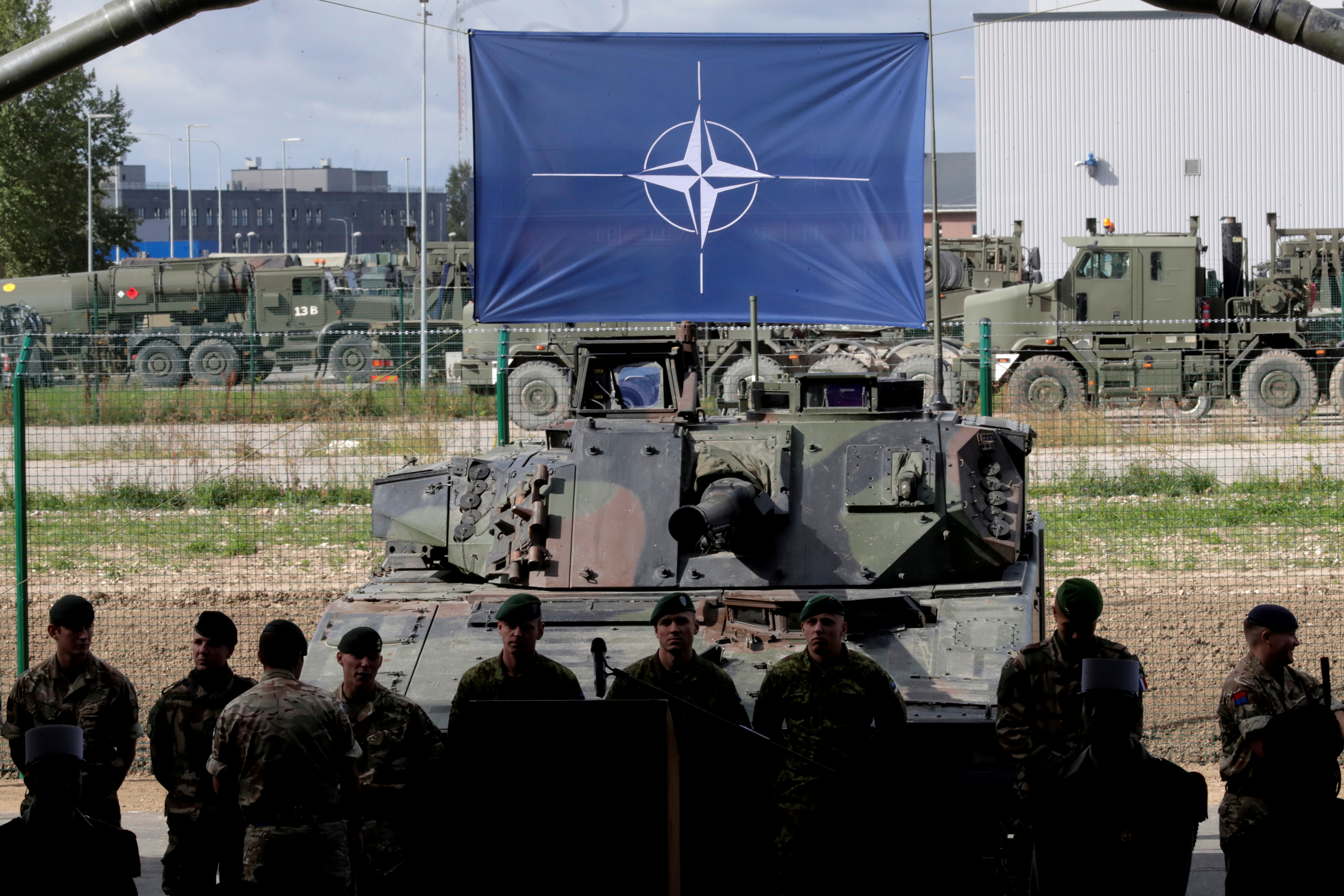 NATO eFP battle group soldiers wait for NATO Secretary General Jens Stoltenberg visit the Tapa military base in Estonia.