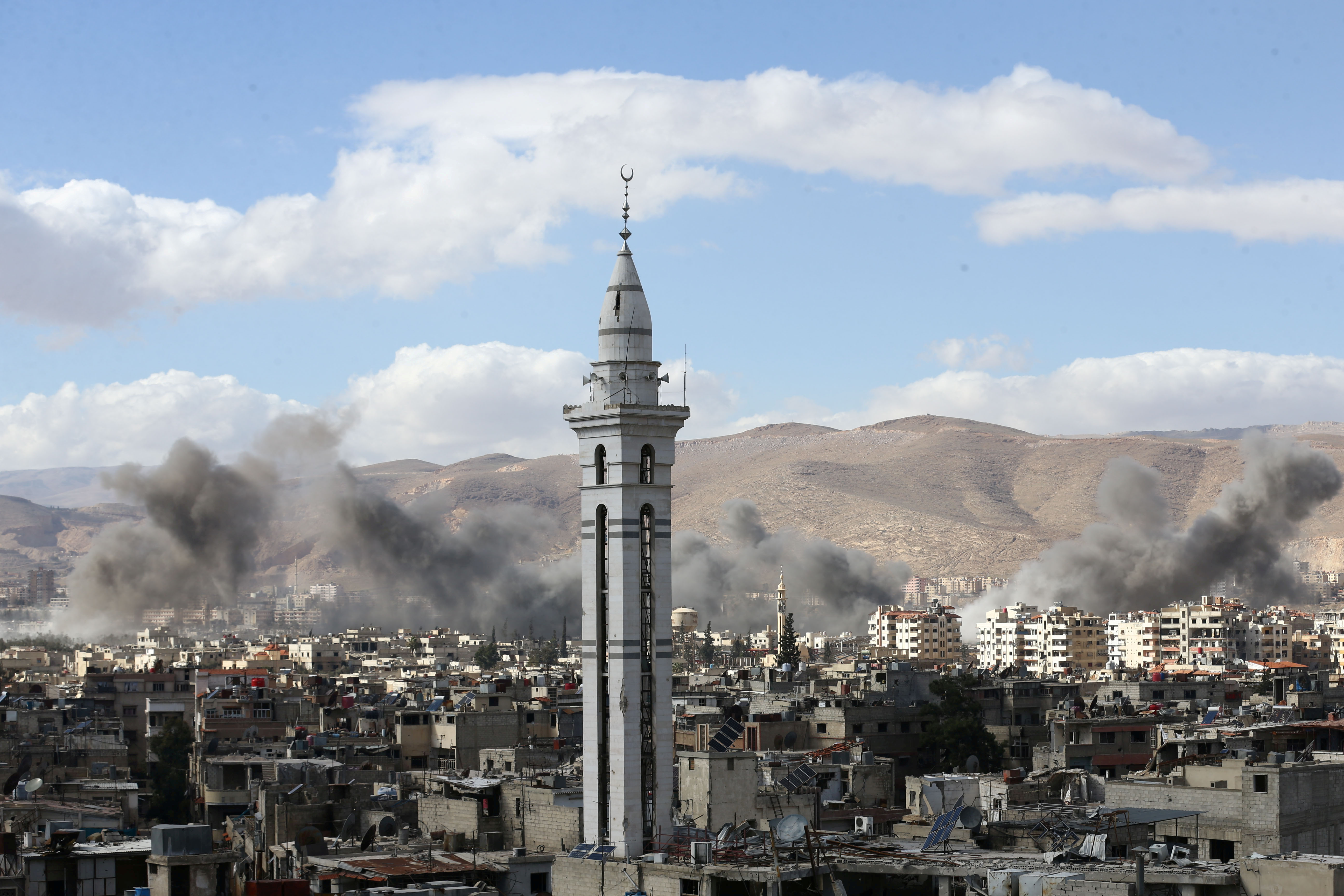 Smoke rises from the besieged Eastern Ghouta in Damascus, Syria, Feb. 27, 2018.